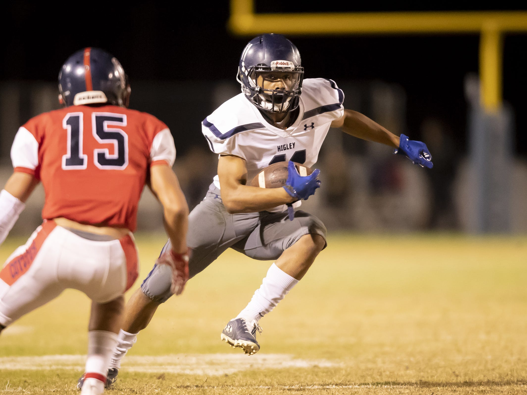 Junior wide receiver Isaiah Eastman (11) of the Higley Knights runs the ball against the Centennial Coyotes in the playoffs at Willow Canyon High School on Friday, November 16, 2018 in Surprise, Arizona. #azhsfb