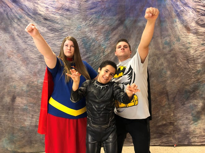 Photographer Patty Kaufman captured this super family, Kody and Amanda Amour  with newly adopted son Michael, at Maricopa County's National Adoption Day on Nov. 17, 2018.