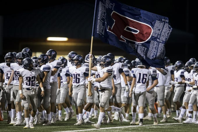 Perry takes the field before the game against Pinnacle on Friday, Nov. 16, 2018, at North Canyon High School in Phoenix.  #azhsb