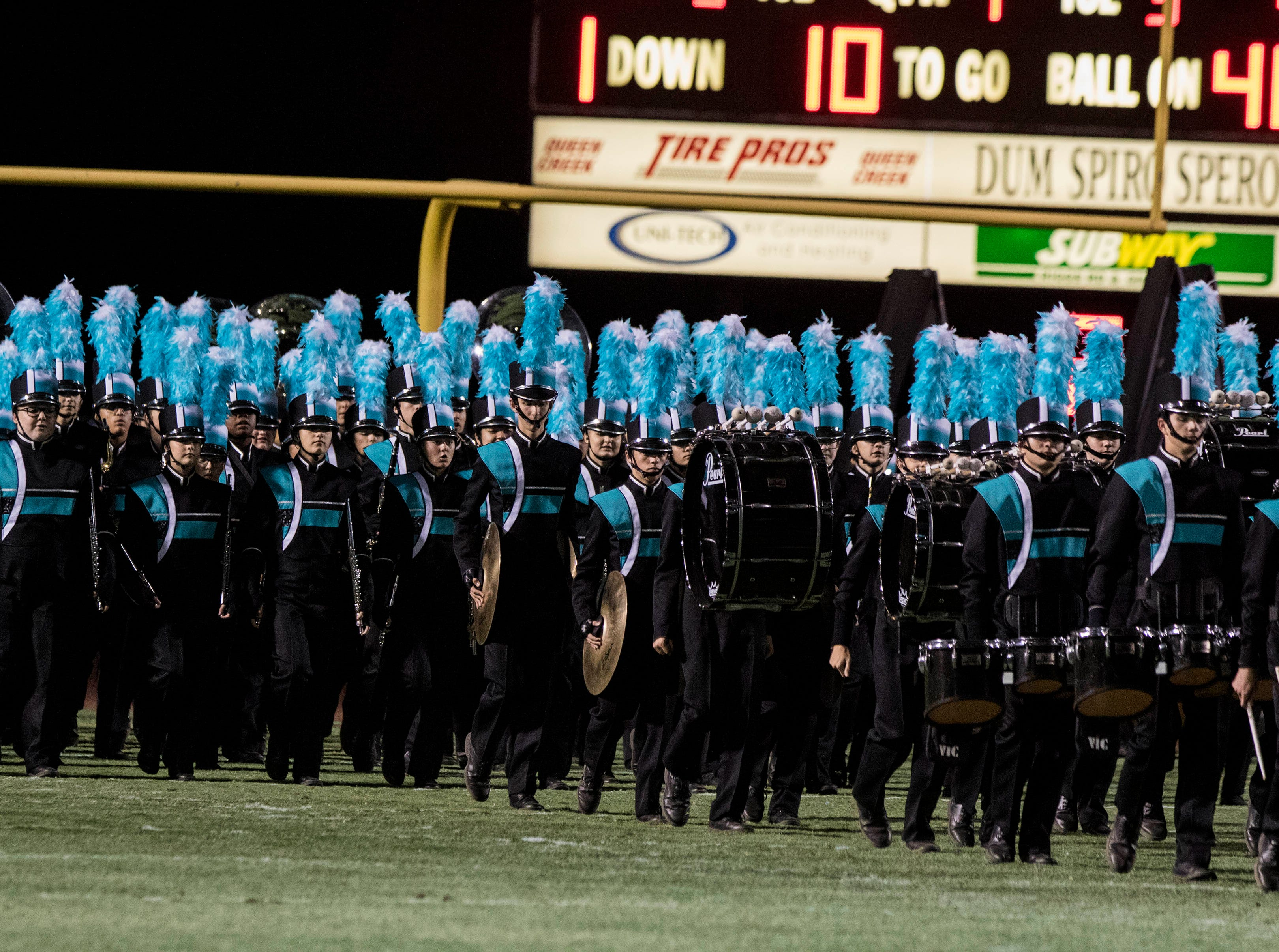 Highland's band takes the field before their game with Chandler at Basha High School in Chandler  Friday, Nov.16, 2018. #azhsfb