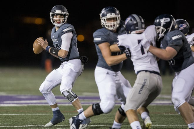 Pinnacle's JD Johnson looks to pass against Perry in the first half on Friday, Nov. 16, 2018, at North Canyon High School in Phoenix.  #azhsb