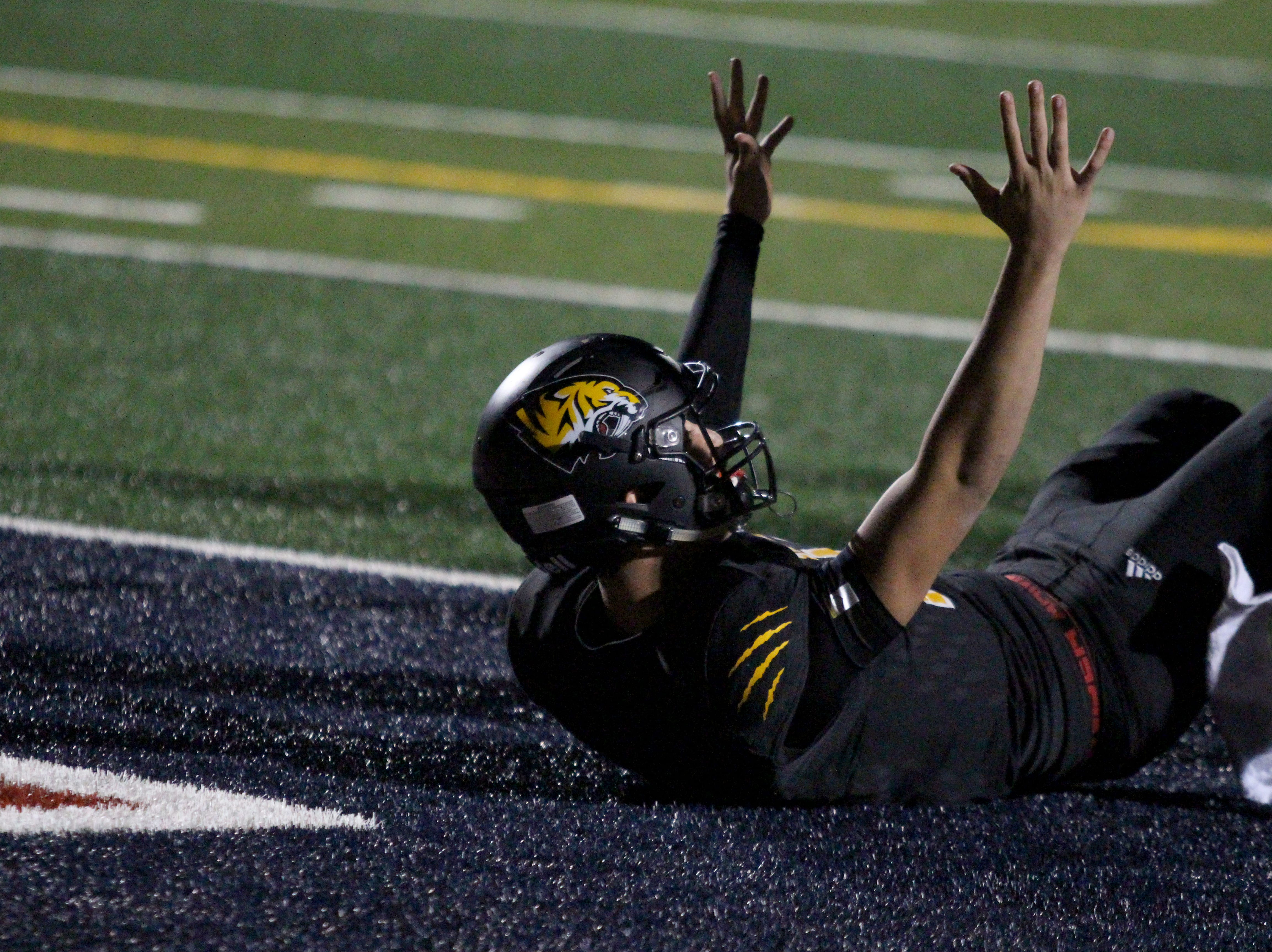 Saguaro's Tyler Beverett makes the touchdown signal after coming up just short of the end zone against Desert Edge on Friday night at Coronado High School on Nov. 16, 2018.