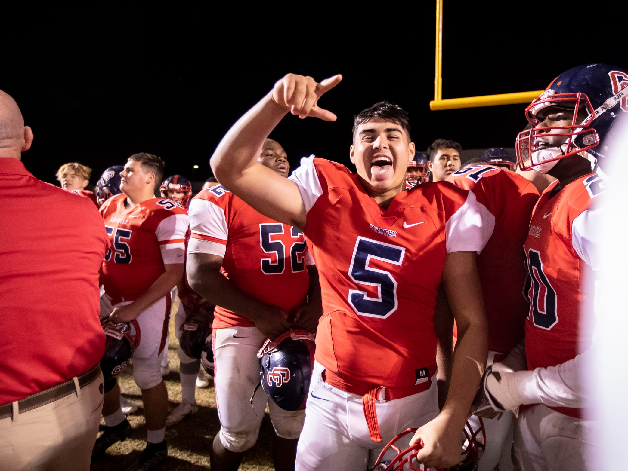 The Centennial Coyotes celebrate following their 48-13 win against the Higley Knights in a 5A semifinals at Willow Canyon High School on Friday, November 16, 2018 in Surprise, Arizona. #azhsfb