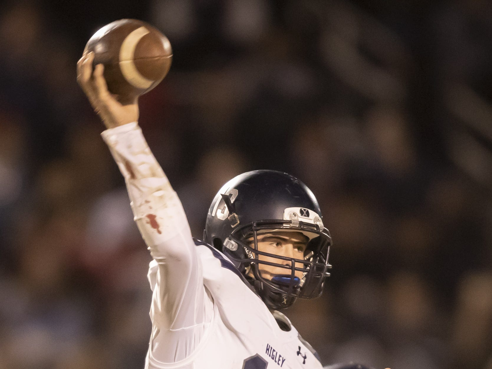 Senior quarterback Spencer Brasch (13) of the Higley Knights throws a pass against the Centennial Coyotes in the playoffs at Willow Canyon High School on Friday, November 16, 2018 in Surprise, Arizona. #azhsfb
