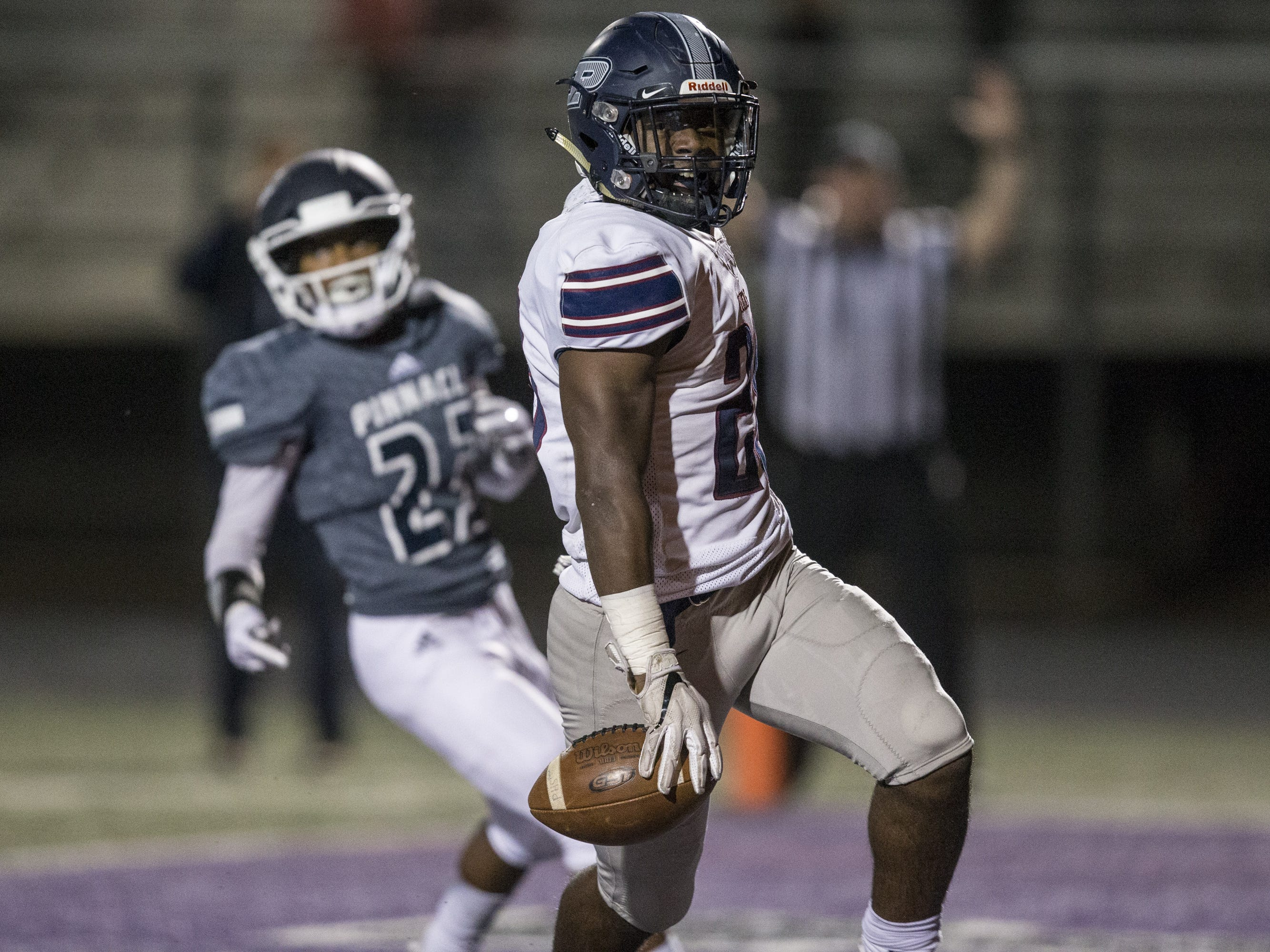 Perry's Jalen Young rushes for a touchdown against Pinnacle in the first half on Friday, Nov. 16, 2018, at North Canyon High School in Phoenix.  #azhsb