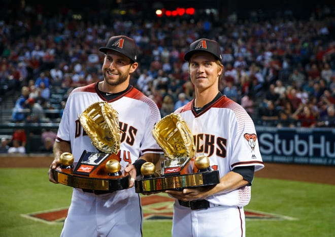 Mar 29, 2018: Arizona Diamondbacks first baseman Paul Goldschmidt (left) and pitcher Zack Greinke celebrates with his Rawlings Gold Glove trophy award prior to the game against the Colorado Rockies during Opening Day at Chase Field.