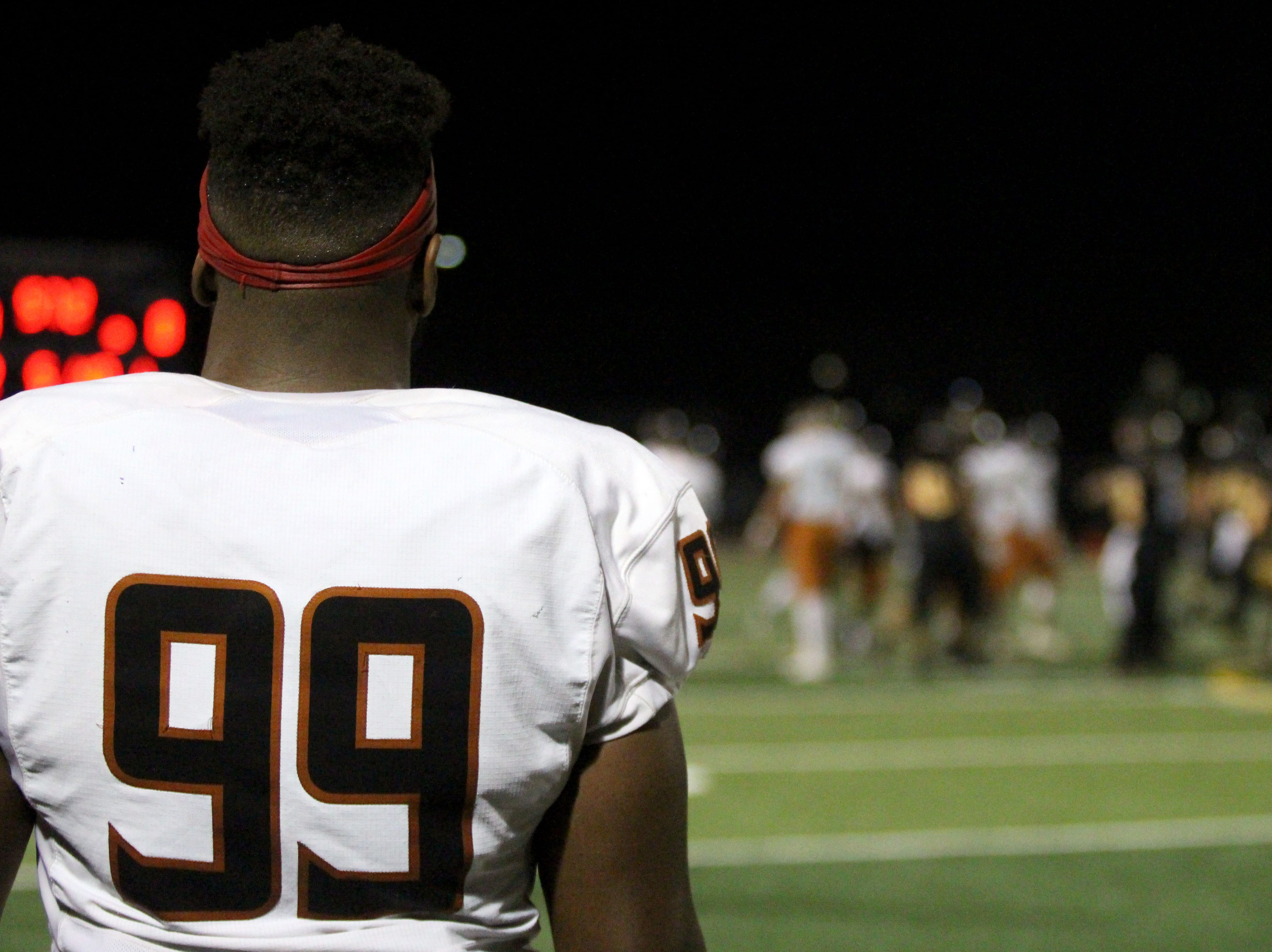 Desert Edge's Nassir Simms looks toward the field during game against Saguaro on Friday night at Coronado High School on Nov. 16, 2018.