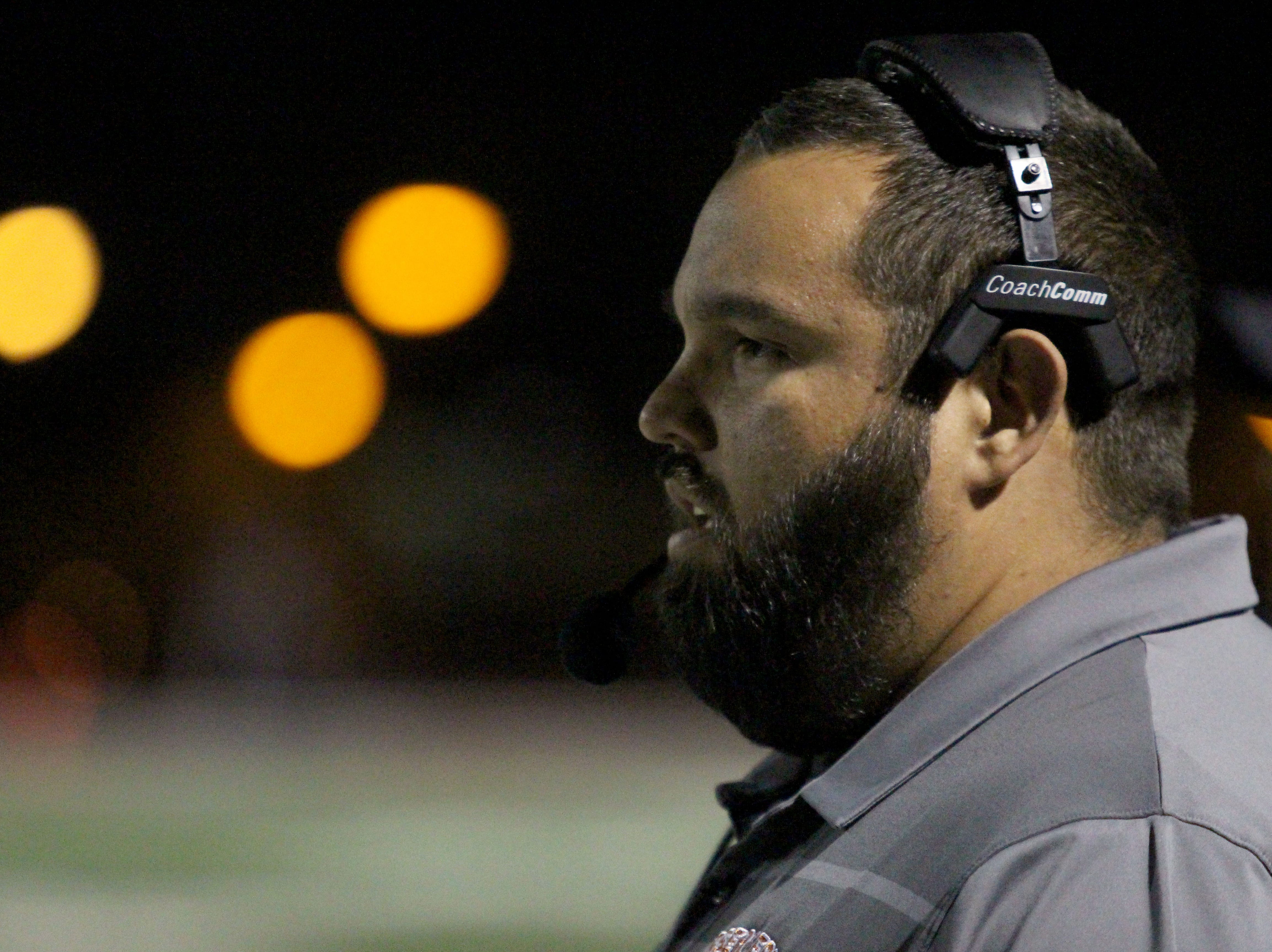 Desert Edge coach Jose Lucero looks toward the field during game against Saguaro on Friday night at Coronado High School on Nov. 16, 2018.