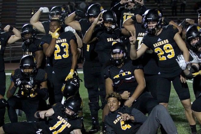 Saguaro players pose after beating Desert Edge to move onto the state championship game on Friday night at Coronado High School on Nov. 16, 2018.