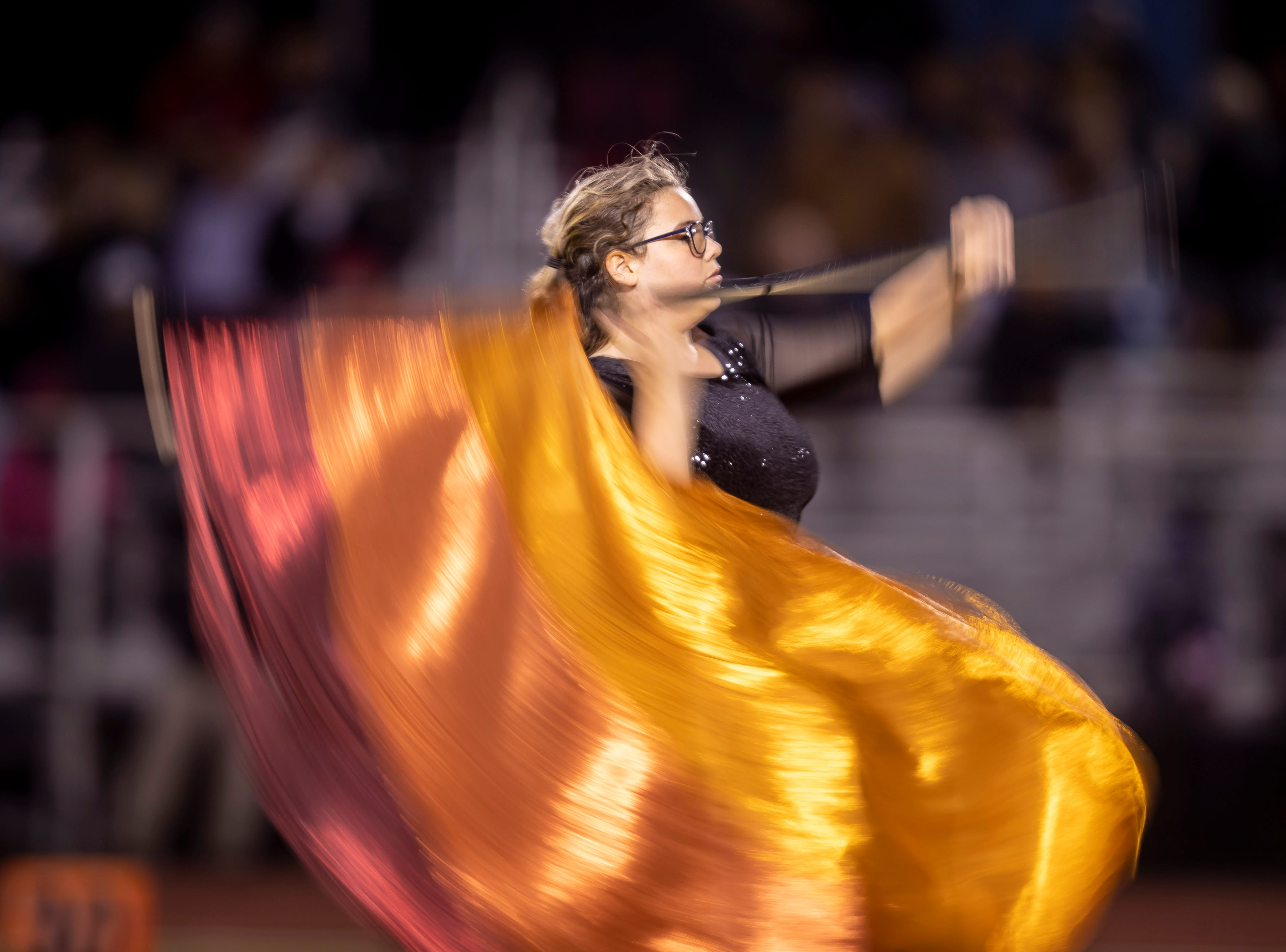 The Centennial Coyotes marching band performs at halftime during the game against the Higley Knights in the 5A semi-finals at Willow Canyon High School on Friday, November 16, 2018 in Surprise, Arizona. #azhsfb