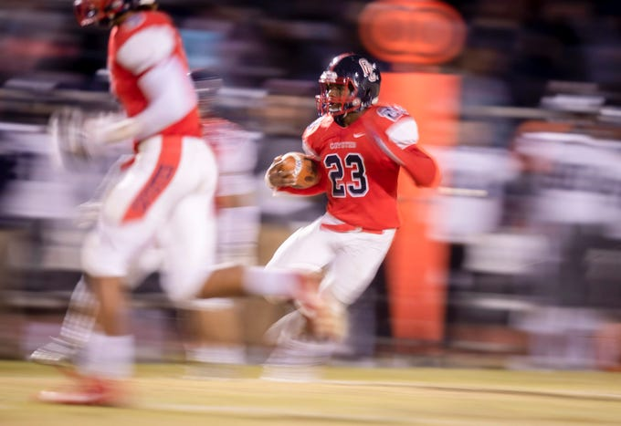 Senior wide receiver A. J. Jackson (23) of the Centennial Coyotes runs the ball against the Higley Knights in the 5A semi-finals at Willow Canyon High School on Friday, November 16, 2018 in Surprise, Arizona. #azhsfb