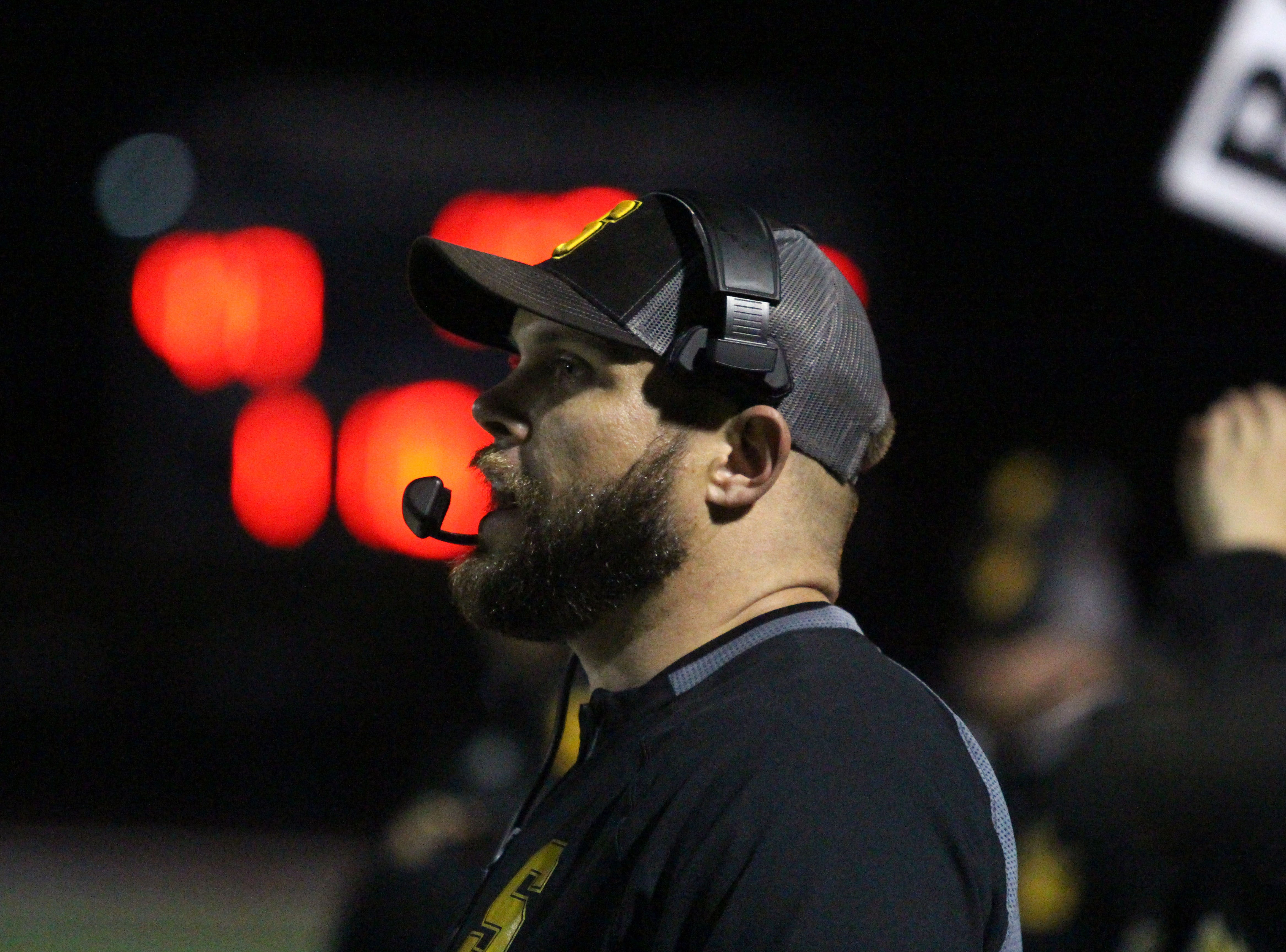 Saguaro coach Kyle caldwell looks towards the field during game against Desert Edge on Friday night at Coronado High School on Nov. 16, 2018.