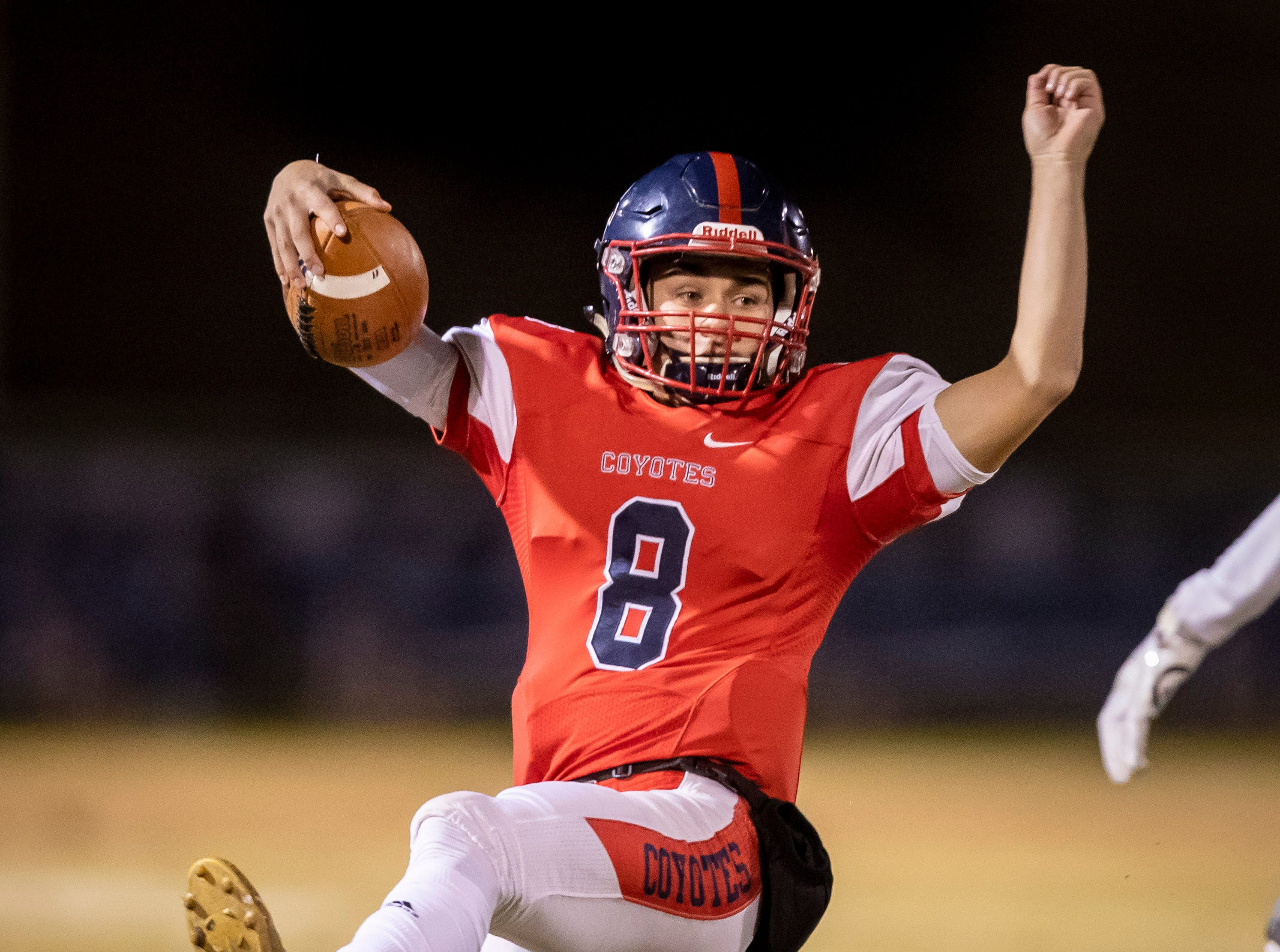 Junior quarterback Jonathan Morris (8) of the Centennial Coyotes slides against the Higley Knights in the 5A semi-finals at Willow Canyon High School on Friday, November 16, 2018 in Surprise, Arizona. #azhsfb