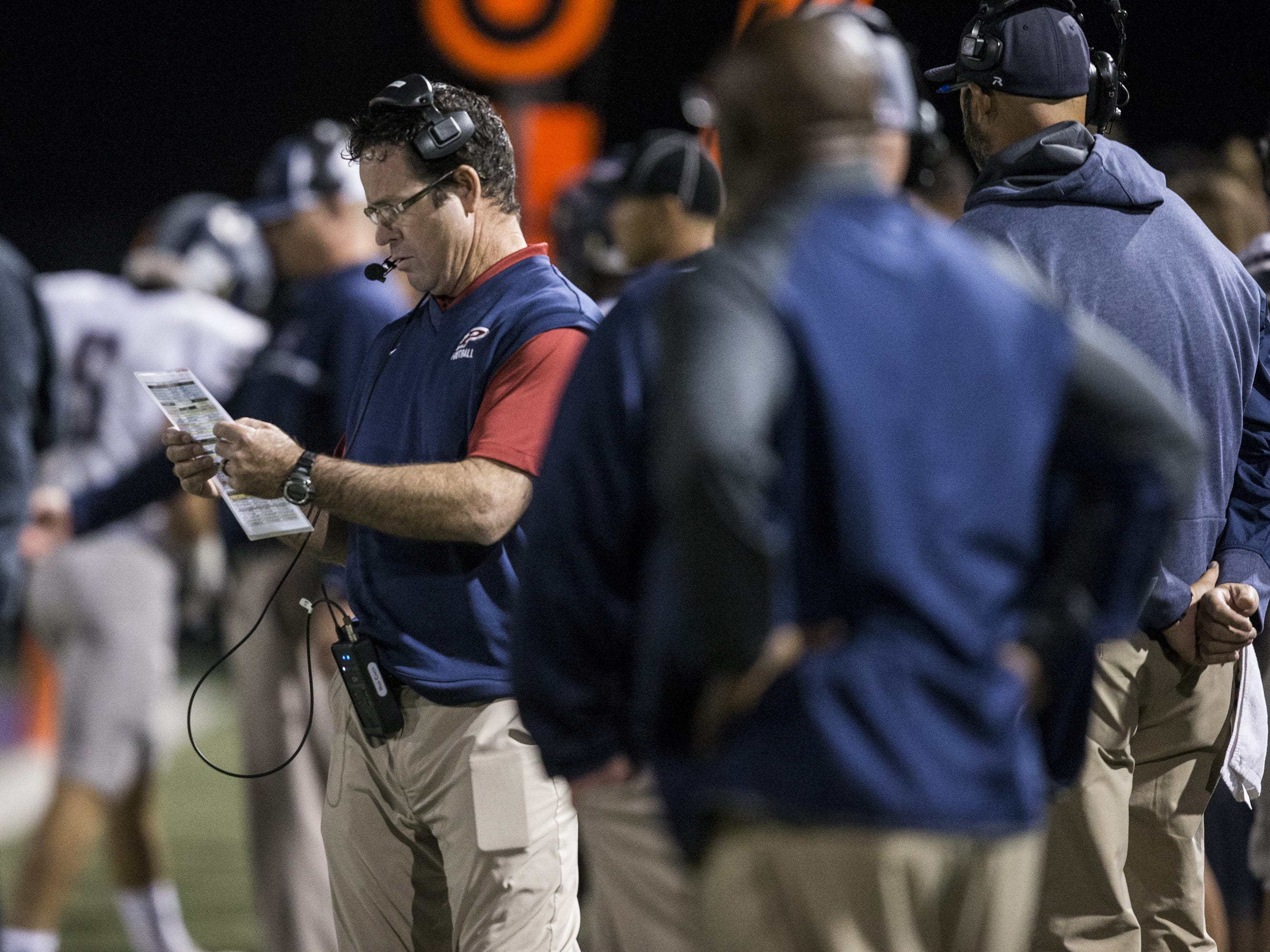 Perry head coach Preston Jones looks at a play sheet during the game against Pinnacle on Friday, Nov. 16, 2018, at North Canyon High School in Phoenix.  #azhsb