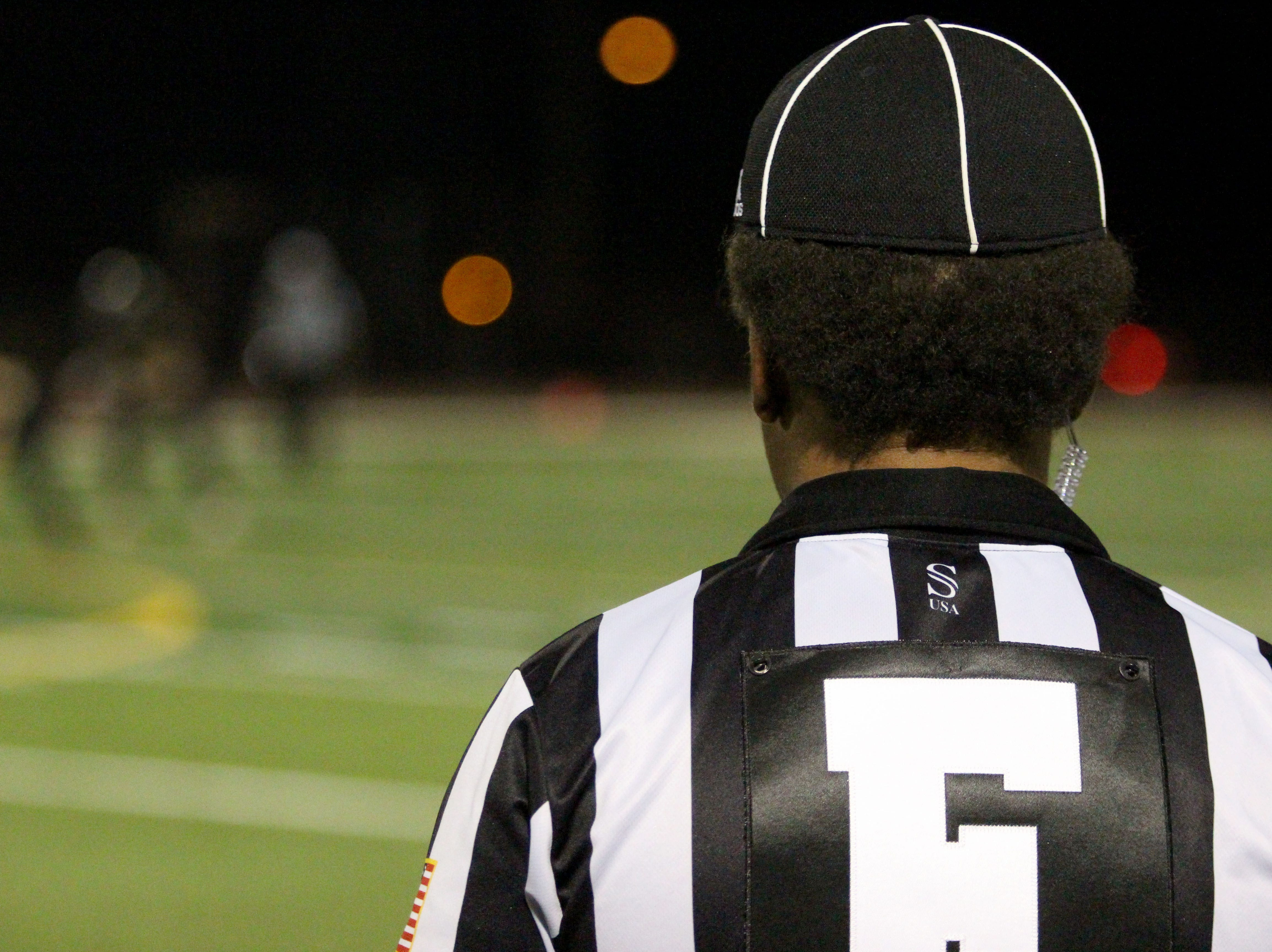 The referee watches as Desert Edge plays Saguaro on Friday night at Coronado High School on Nov. 16, 2018.