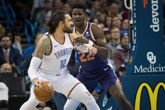 Nov 12, 2018: Oklahoma City Thunder center Steven Adams (12) controls the ball as Phoenix Suns center Deandre Ayton (22) defends during the second half at Chesapeake Energy Arena.