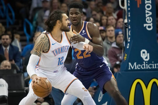 Nov 12, 2018: Oklahoma City Thunder center Steven Adams (12) controls the ball as Phoenix Suns center Deandre Ayton (22) defends during the second half at Chesapeake Energy Arena.