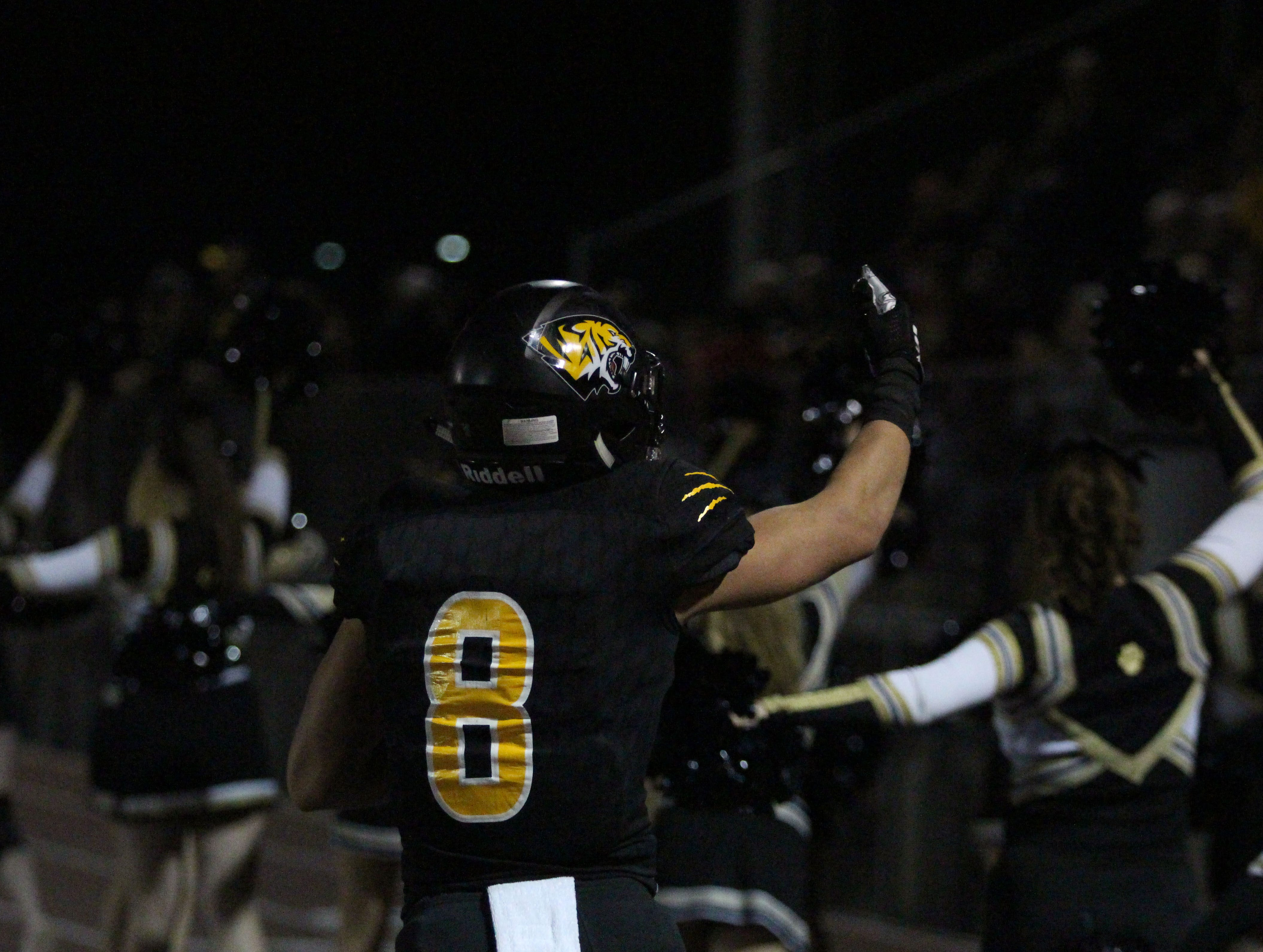 Saguaro's Connor Soelle celebrates towards the crowd against Desert Edge on Friday night at Coronado High School on Nov. 16, 2018.