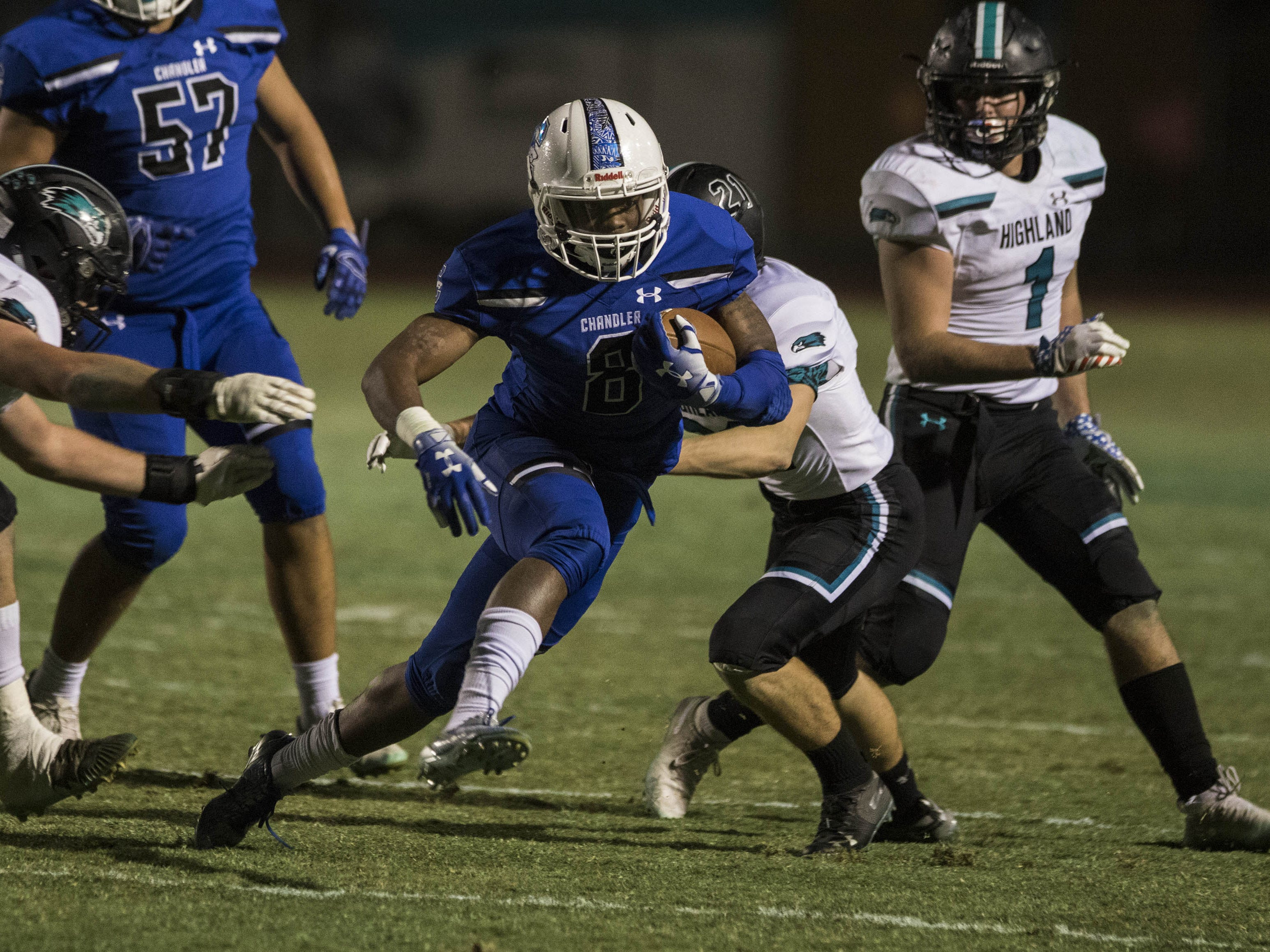 Chandler's Jaheim Brown-Taylor finds a hole against Highland during their game in Chandler Friday, Nov.16, 2018. #azhsfb