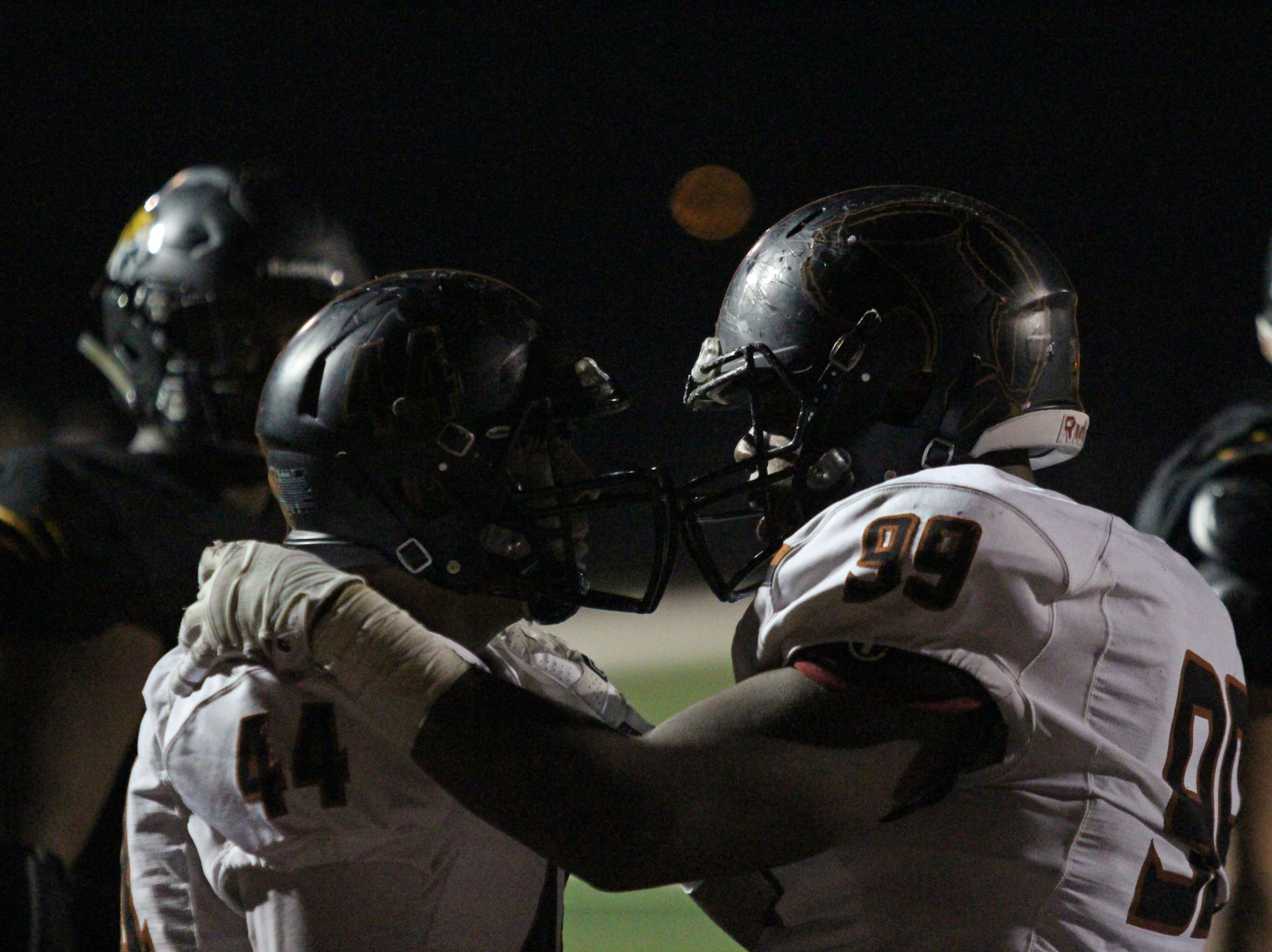 "Desert Edge's Nassir Simms (99) tells Max Crosner (44) ""It's okay,"" while trailing big during game against Saguaro on Friday night at Coronado High School on Nov. 16, 2018."