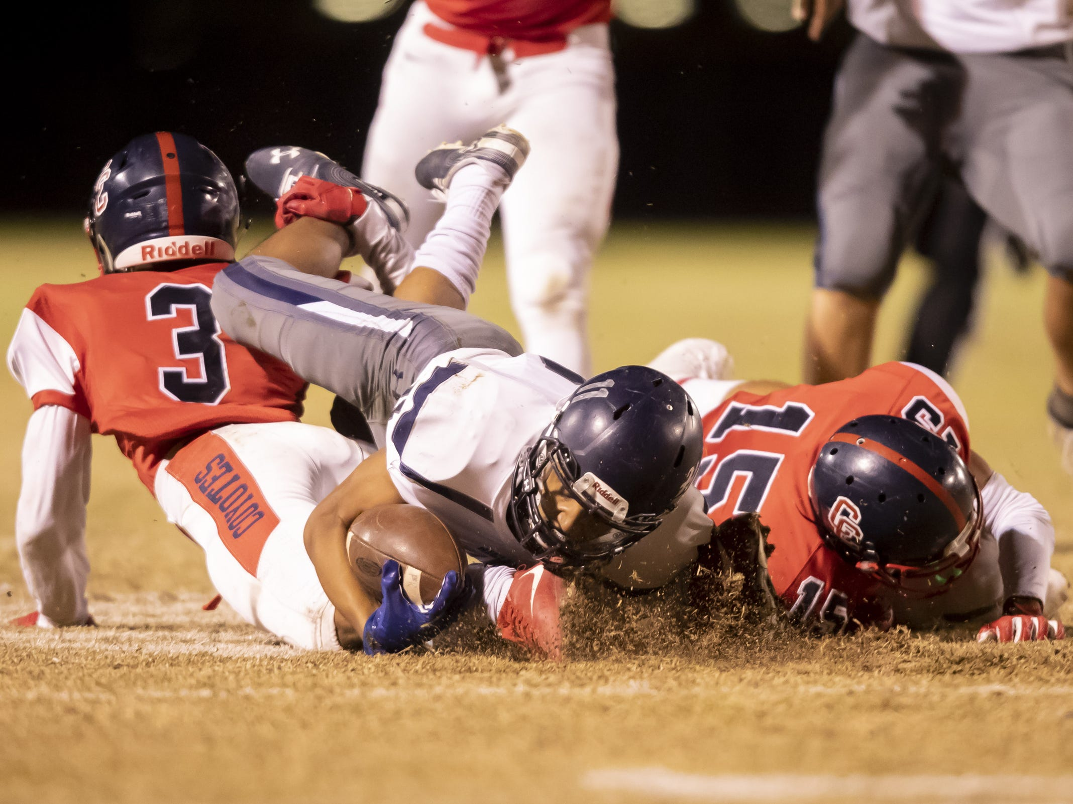 Junior wide receiver Isaiah Eastman (11) of the Higley Knights is tackled by junior cornerback Eric Haney (15) of the Centennial Coyotes in the playoffs at Willow Canyon High School on Friday, November 16, 2018 in Surprise, Arizona. #azhsfb