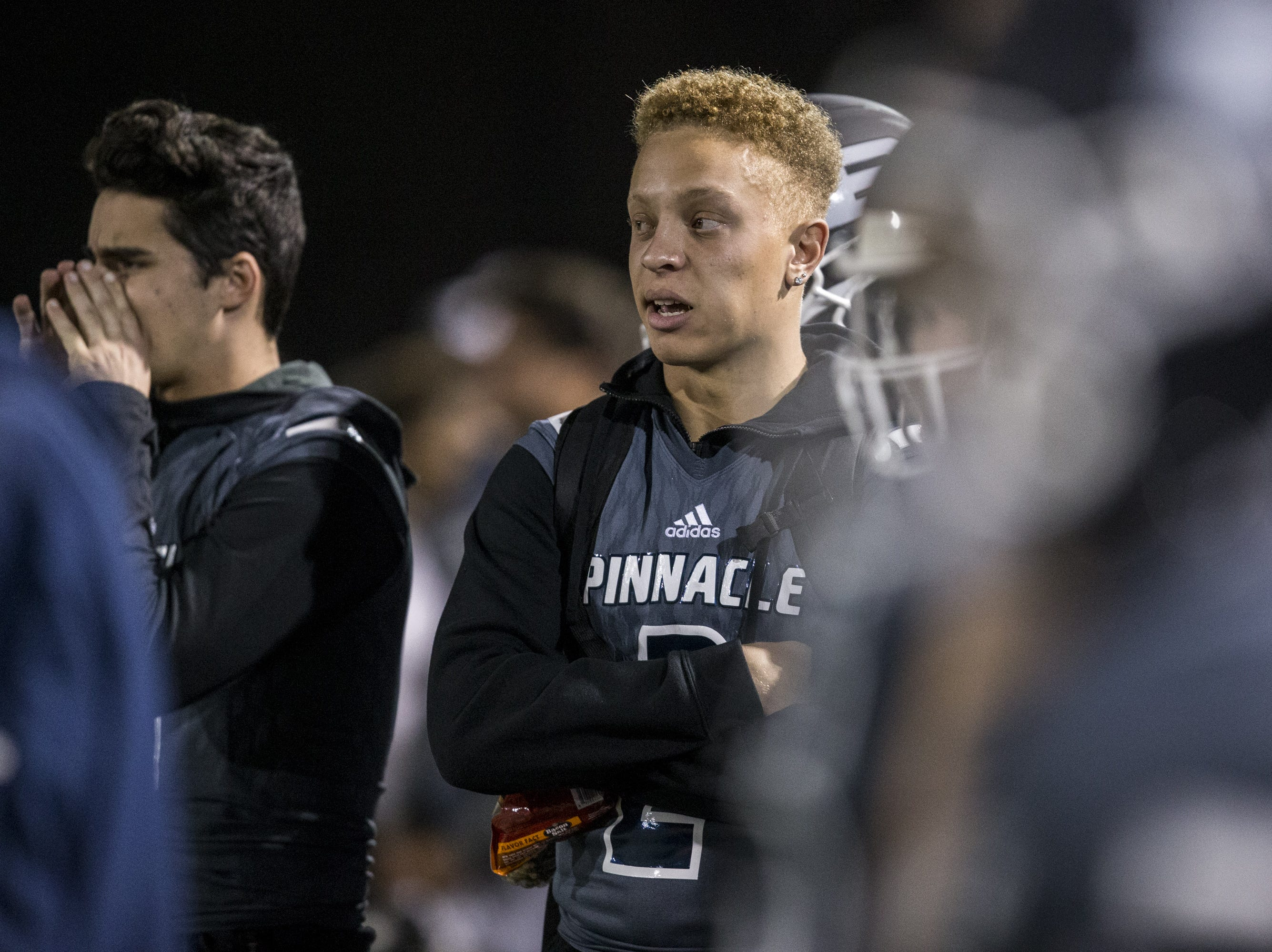 Pinnacle's Spencer Rattler watches the game against Perry from the sideline on Friday, Nov. 16, 2018, at North Canyon High School in Phoenix.  #azhsb