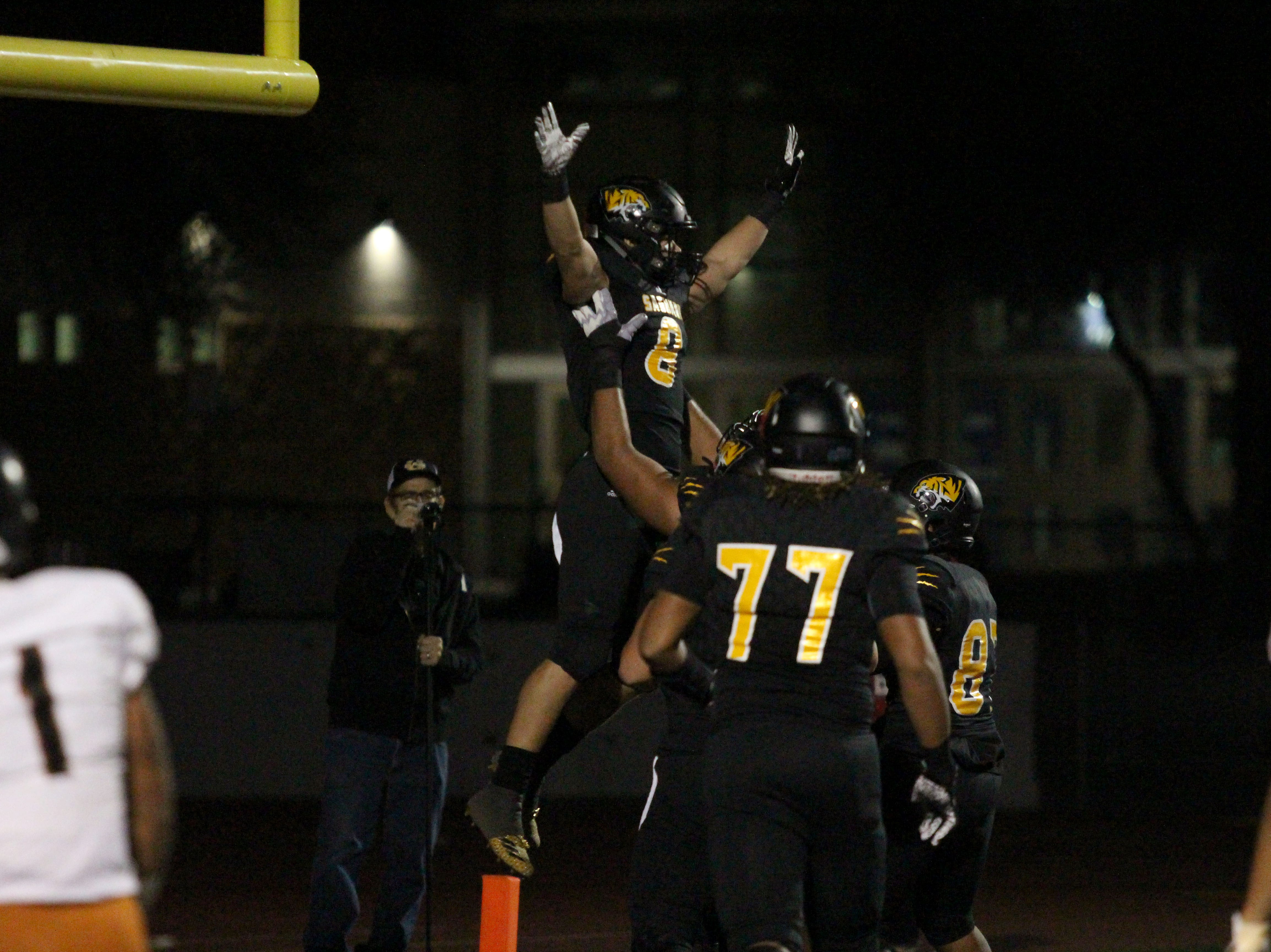 Saguaro's player celebrate after Connor Soelle's touchdown against Desert Edge on Friday night at Coronado High School on Nov. 16, 2018.