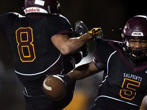 Lathan Ransom and Bijan Robinson celebrate during Salpointe Catholic's 53-6 semifinal win over Sahuaro at Mountain View High School on Friday, Nov. 16, 2018.