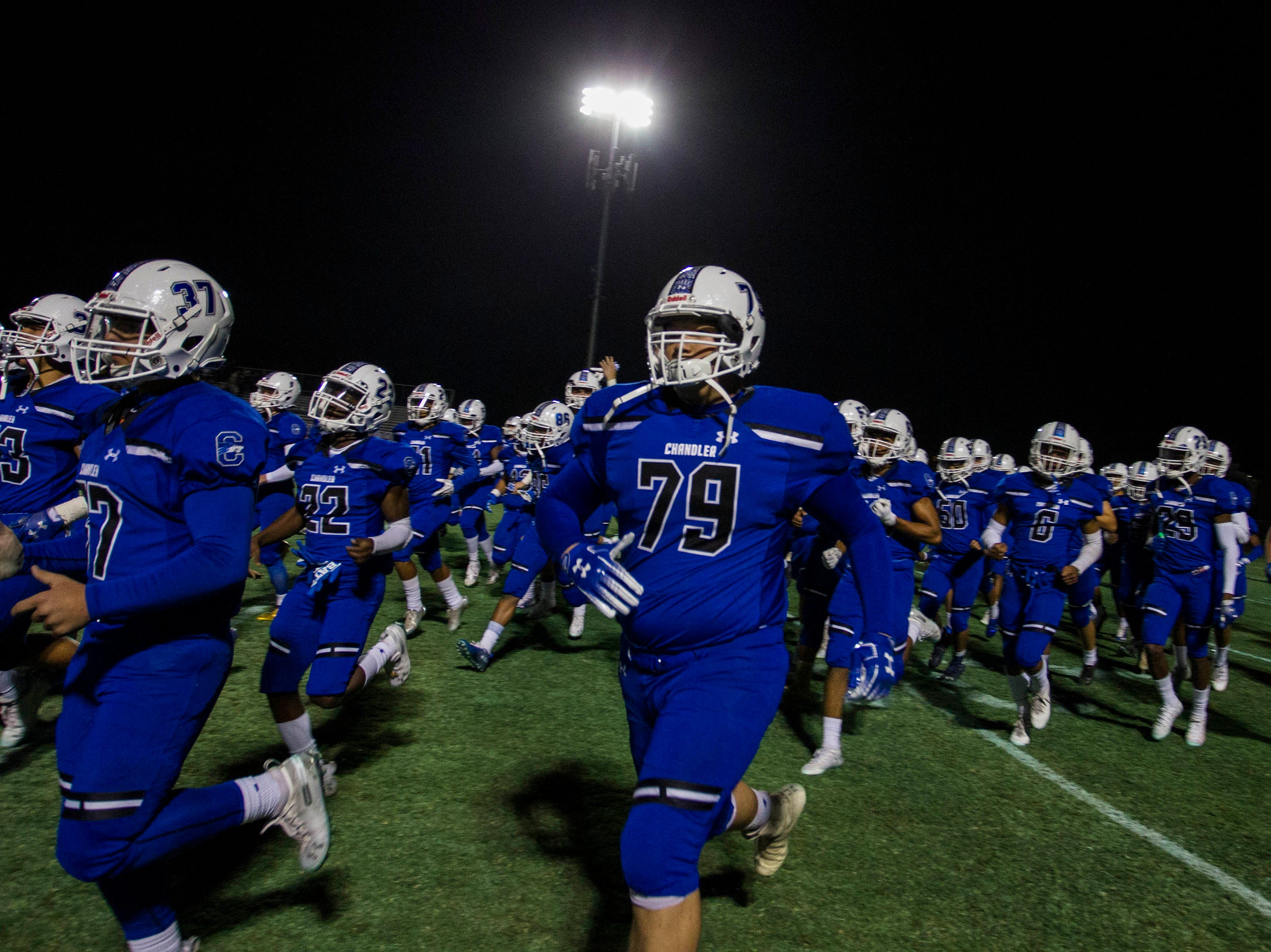 Chandler High players run out onto the field before their game with Highland at Basha High School in Chandler  Friday, Nov.16, 2018. #azhsfb