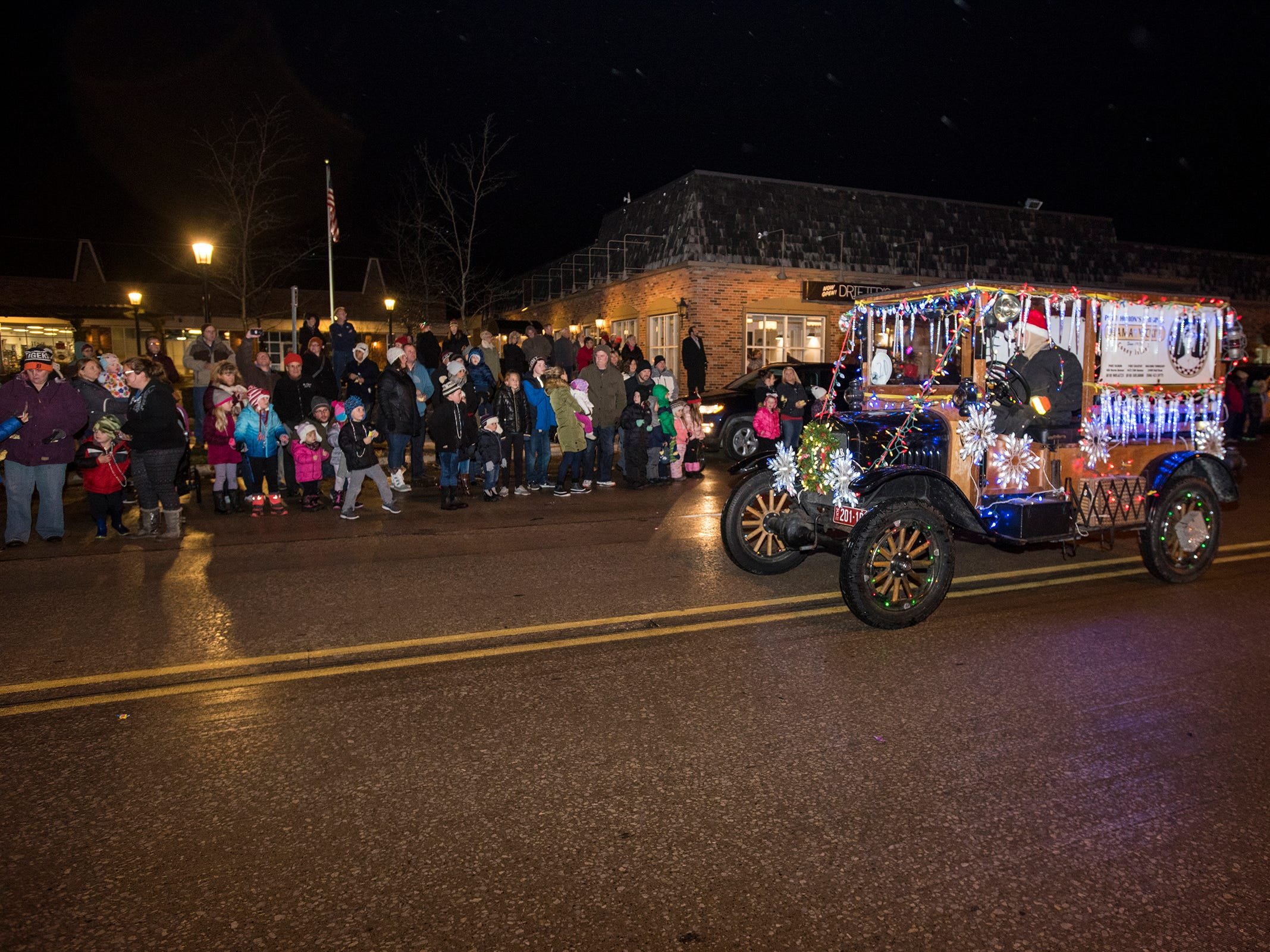 A lighted float drives down Riverside Avenue Friday, Nov. 16, 2018 during the St. Clair Lighted Santa Parade.