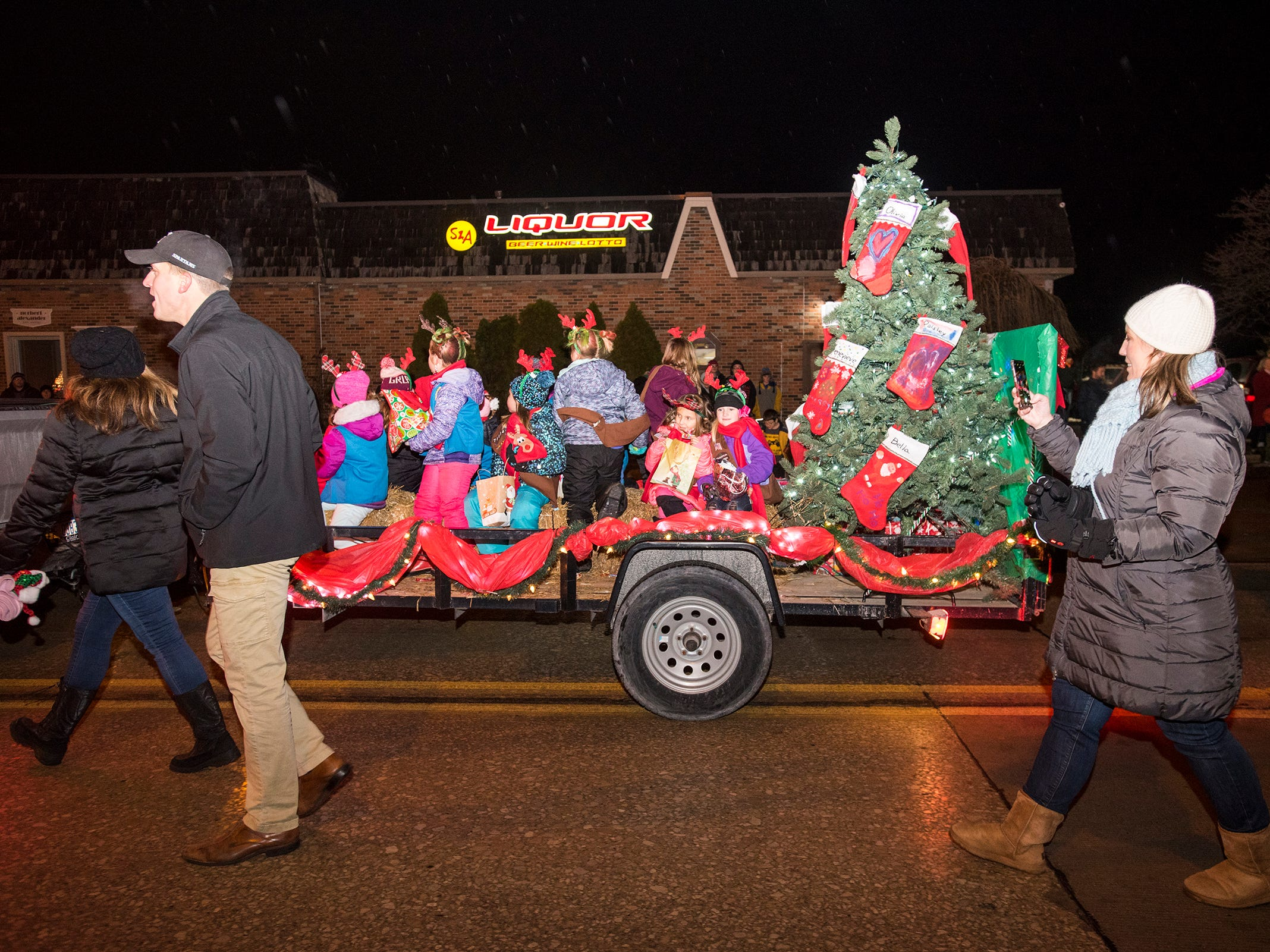 Kids ride on a lighted float Friday, Nov. 16, 2018 during the St. Clair Lighted Santa Parade.
