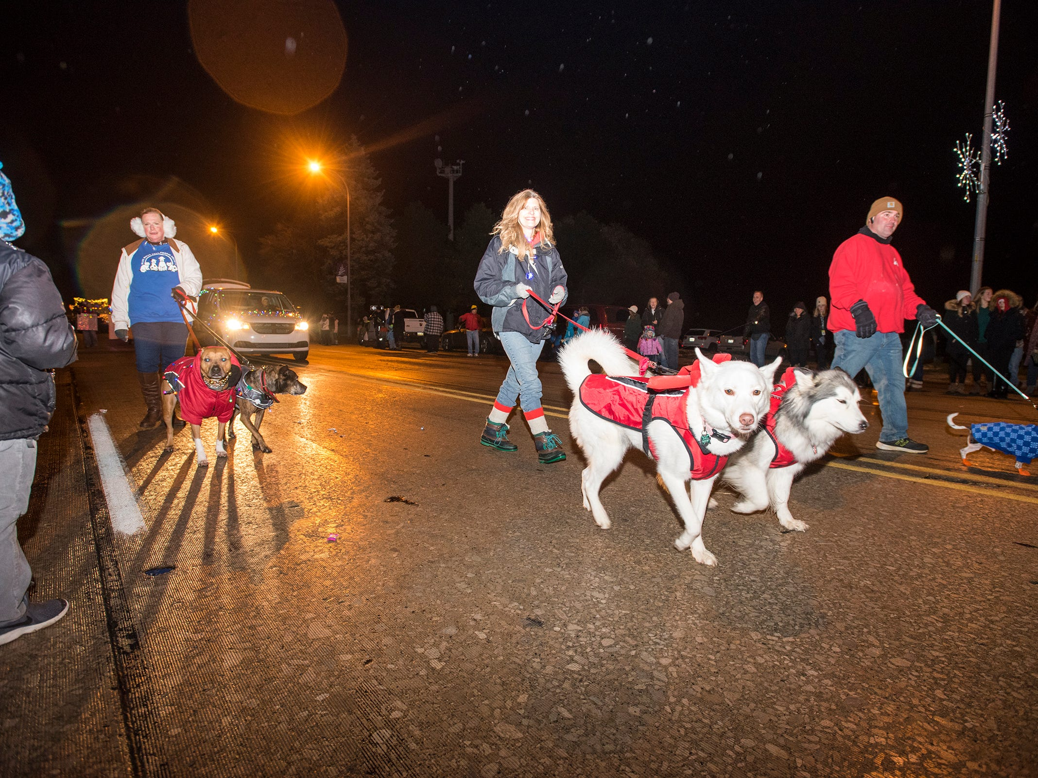 Representatives from the Blue Water Area Humane Society walk down Riverside Avenue Friday, Nov. 16, 2018 during the St. Clair Lighted Santa Parade.