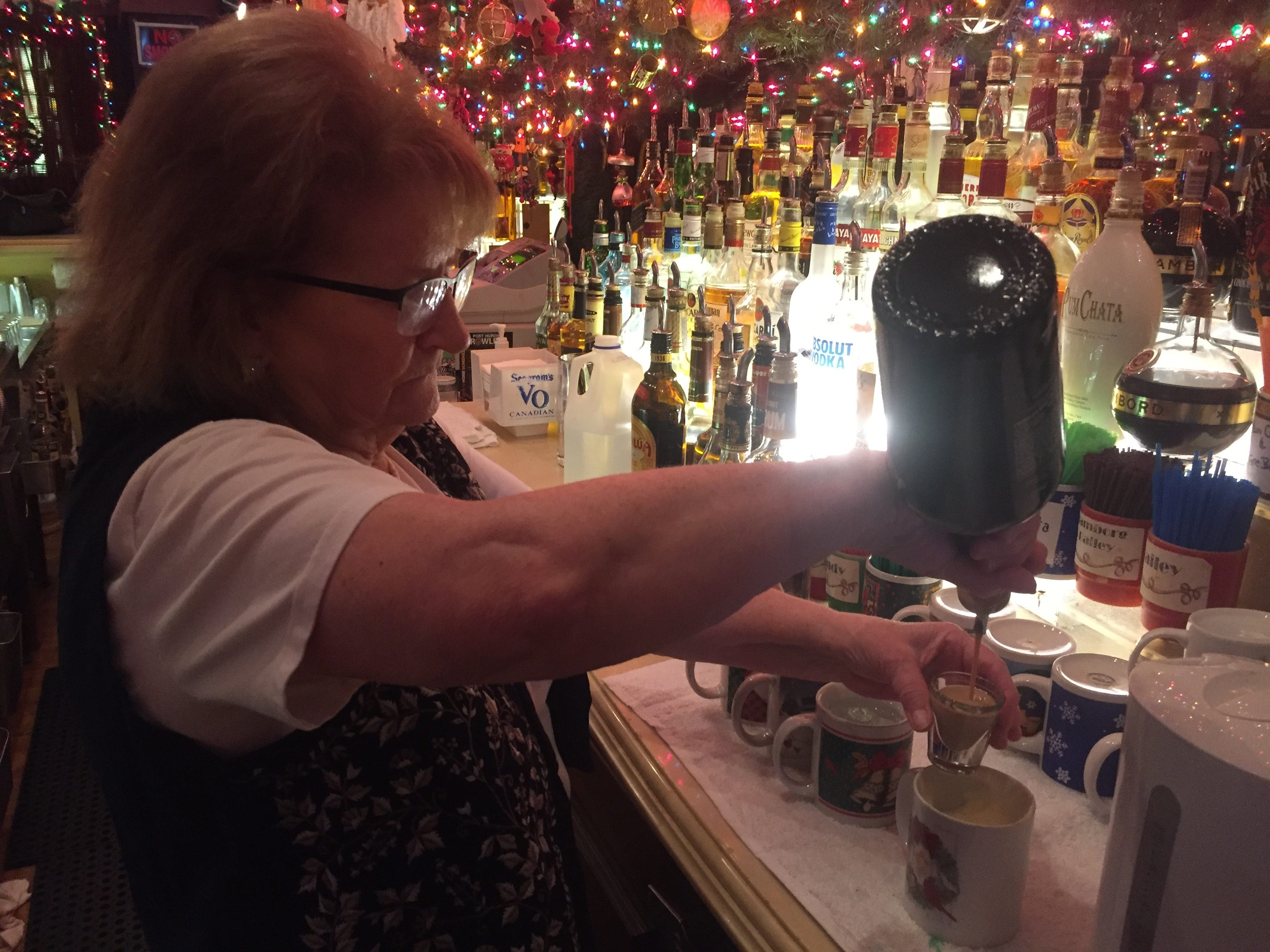 Sue Dunn concocts a Tom and Jerry at the Brass Rail in Port Huron.