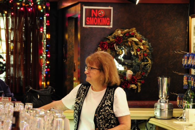Sue Dunn presides over the bar at the Brass Rail in Port Huron.