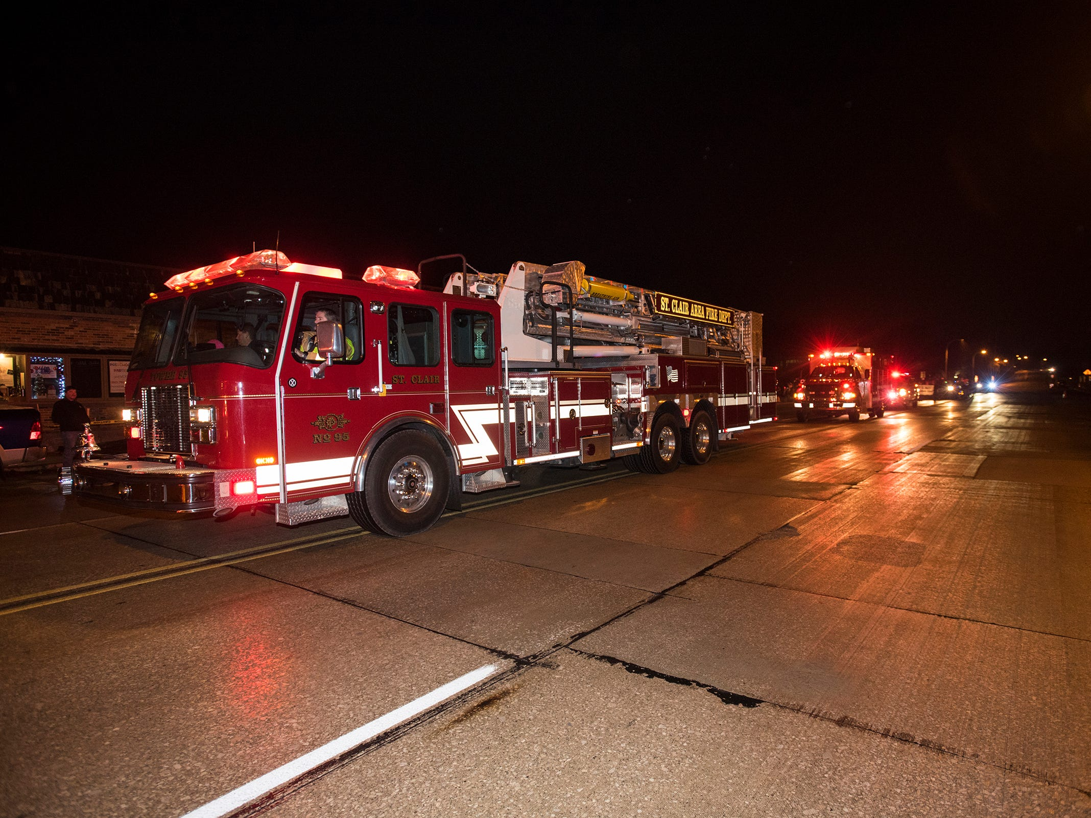 A fleet of emergency vehicles drive down Riverside Avenue Friday, Nov. 16, 2018 during the St. Clair Lighted Santa Parade.