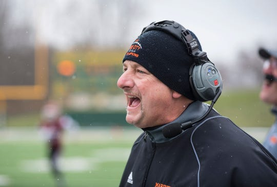 Marine City High School head coach Ron Glodich shouts to the team during a play in the MHSAA Division 5 state football semifinals against Portland High School Saturday, Nov. 17, 2018 at Howell High School.