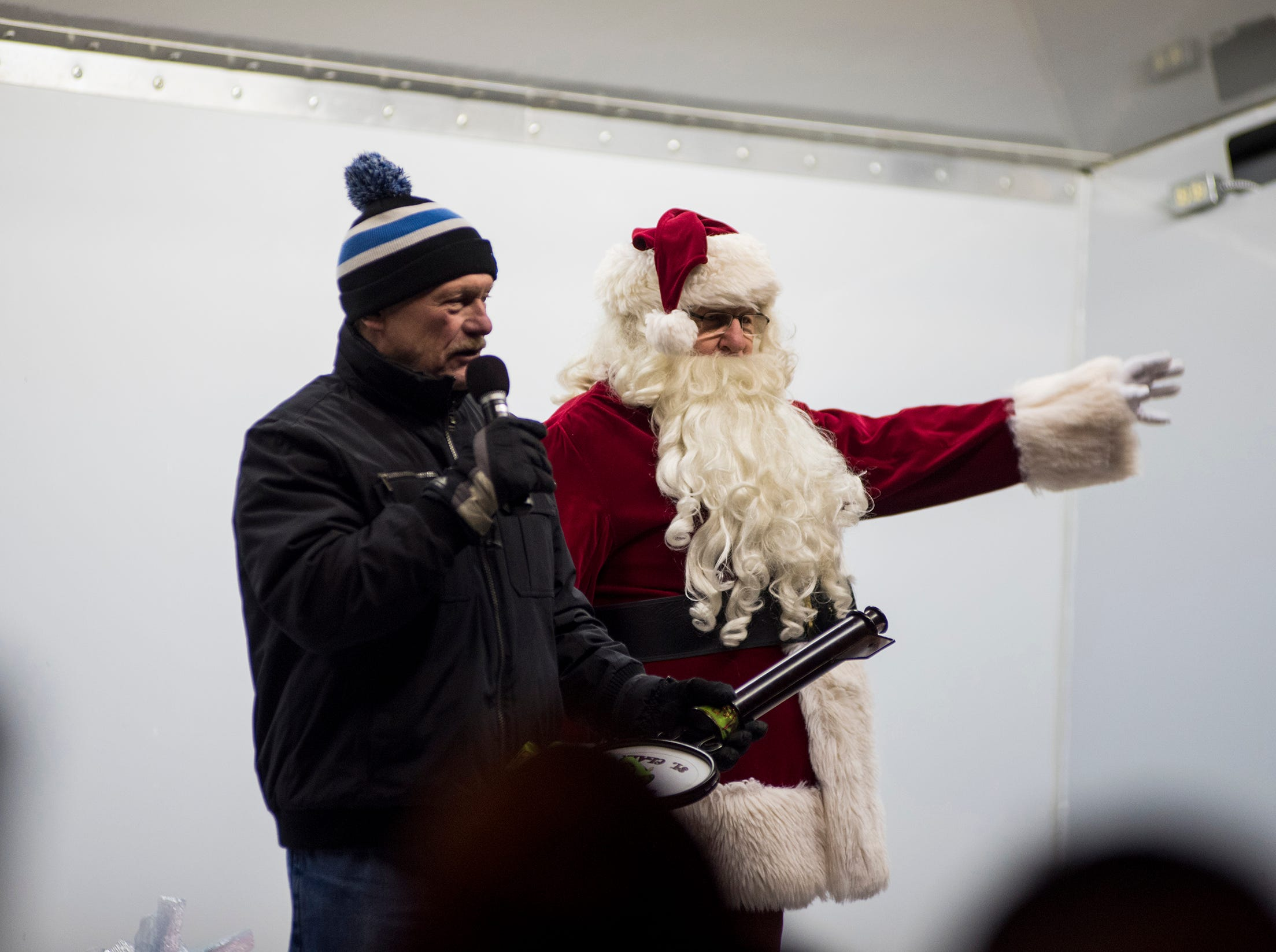 St. Clair Mayor Bill Cedar, left, presents Santa Claus with the key to the city Friday, Nov. 16, 2018 during a Christmas tree lightiing ceremony in St. Clair.