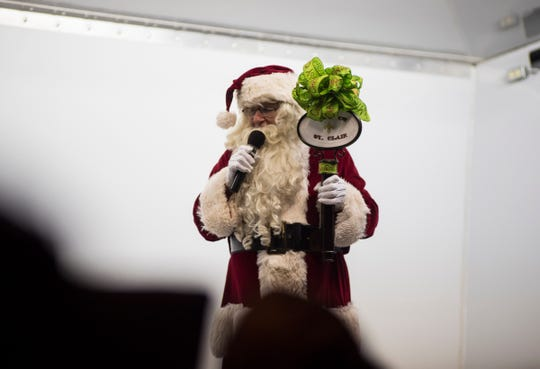 Santa Claus holds the key to St. Clair while he talks during a Christmas tree lighting ceremony Friday, Nov. 16, 2018 in St. Clair.