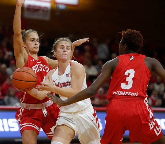 Marist's Claire Oberdorf looks to pass the ball as she is covered by Boston University's, from left, Payton Hauck and Naiyah Thompson during Friday's game in Poughkeepsie on November 16, 2018.