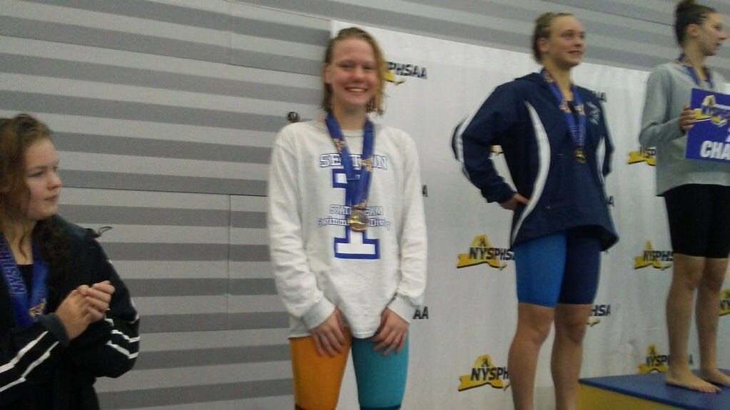 Our Lady of Lourdes swimmer Clare Bosse poses on the podium after taking fifth in two events in the state championships on Saturday.