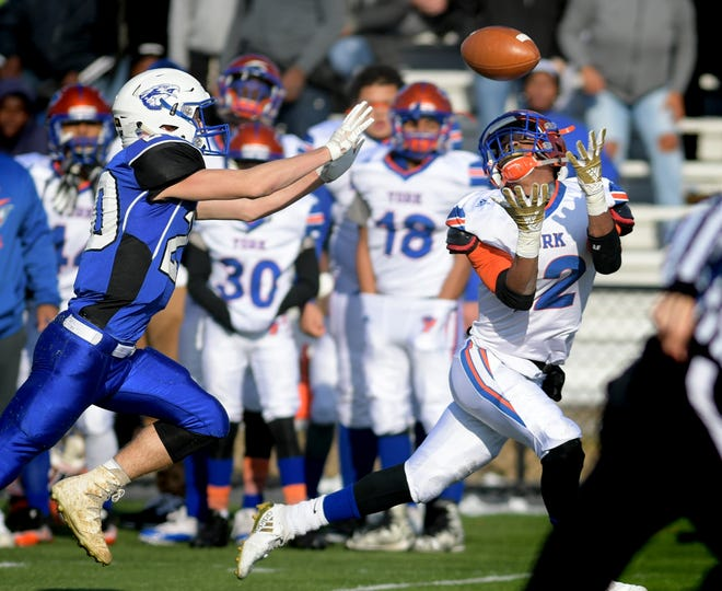 York High's Rob Rideout hauls in a pass behind Cocalico's Austin Landers during a District 3 Class 5-A football semifinal at Manheim Central High School Saturday, Nov. 17, 2018. Bill Kalina photo