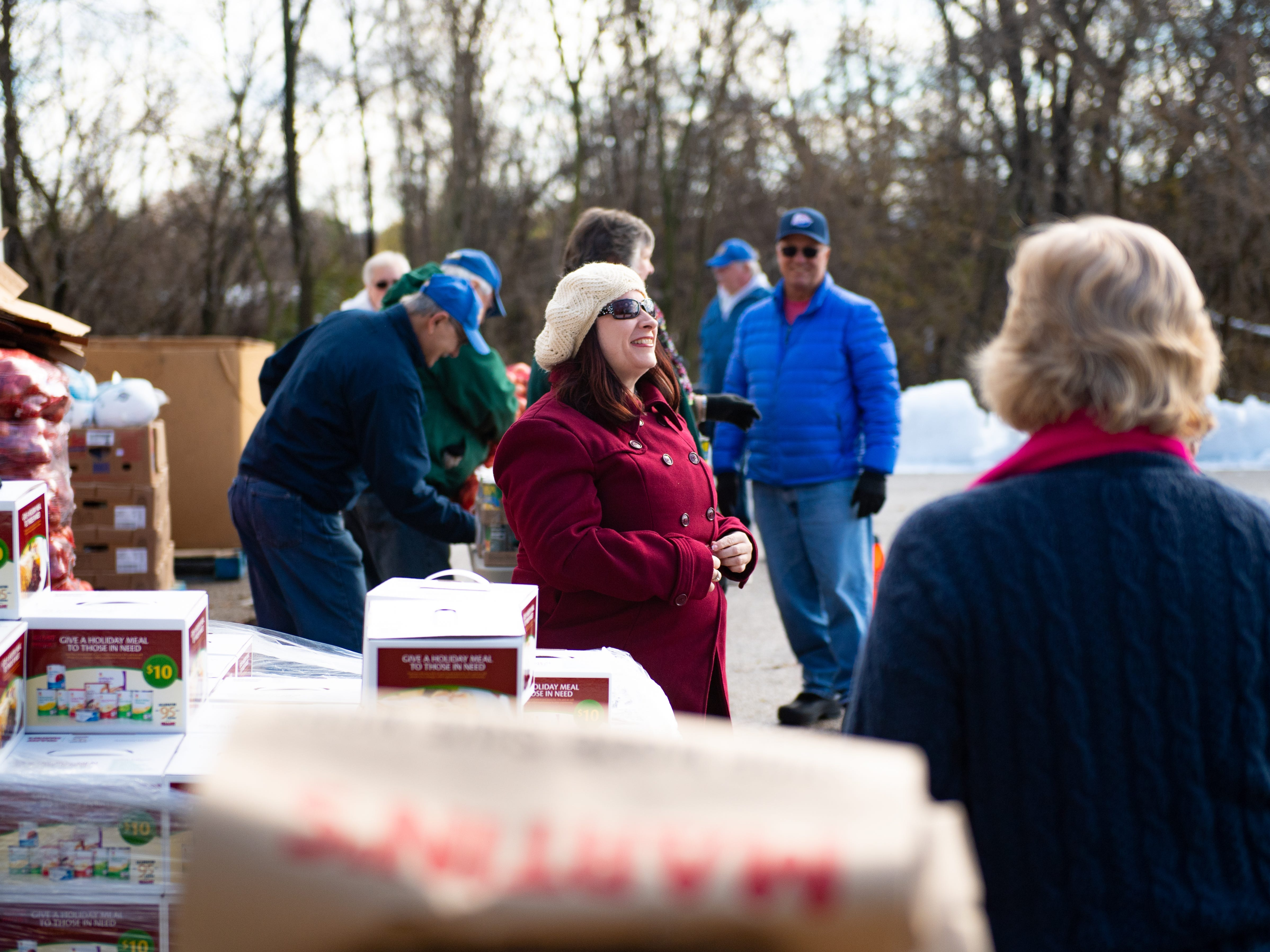 New Hope Ministries Center Manager, Leah Miller, greets every guest that stops by during the Thanksgiving food giveaway, November 16, 2018.