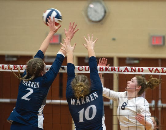 West York's Julia Rill (8) tries to get the ball past the block of Warren's Lydia Latimer (2) and Ellie Lobdell (10) in the PIAA Class 3A girls' volleyball championship at Cumberland Valley HS on Saturday, Nov. 17, 2018.