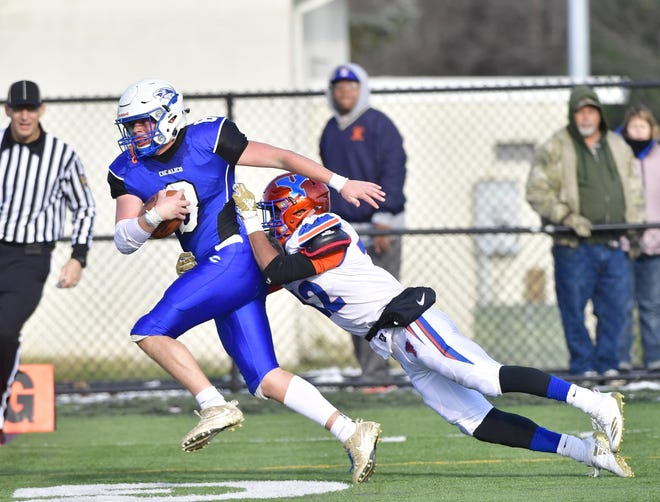 Cocalico's Ben Sola hauls in a long pass on a trick play to score the go-ahead touchdown just before halftime as York High's Rob Rideout reaches out to bring him down in the end zone Saturday, Nov. 17, 2018.