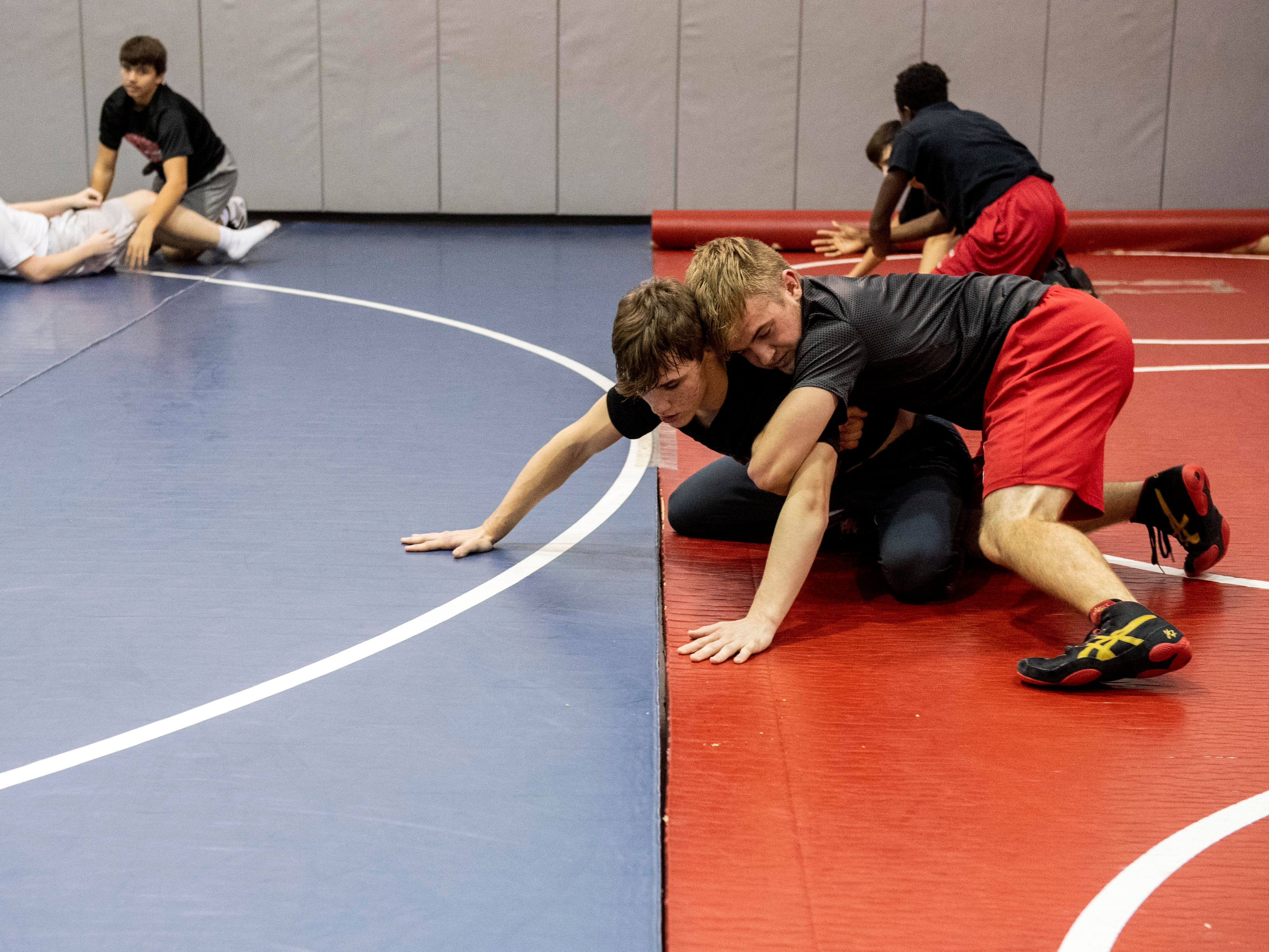 Dover wrestlers practice during the first official day of winter sports practice on Friday, November 16, 2018.
