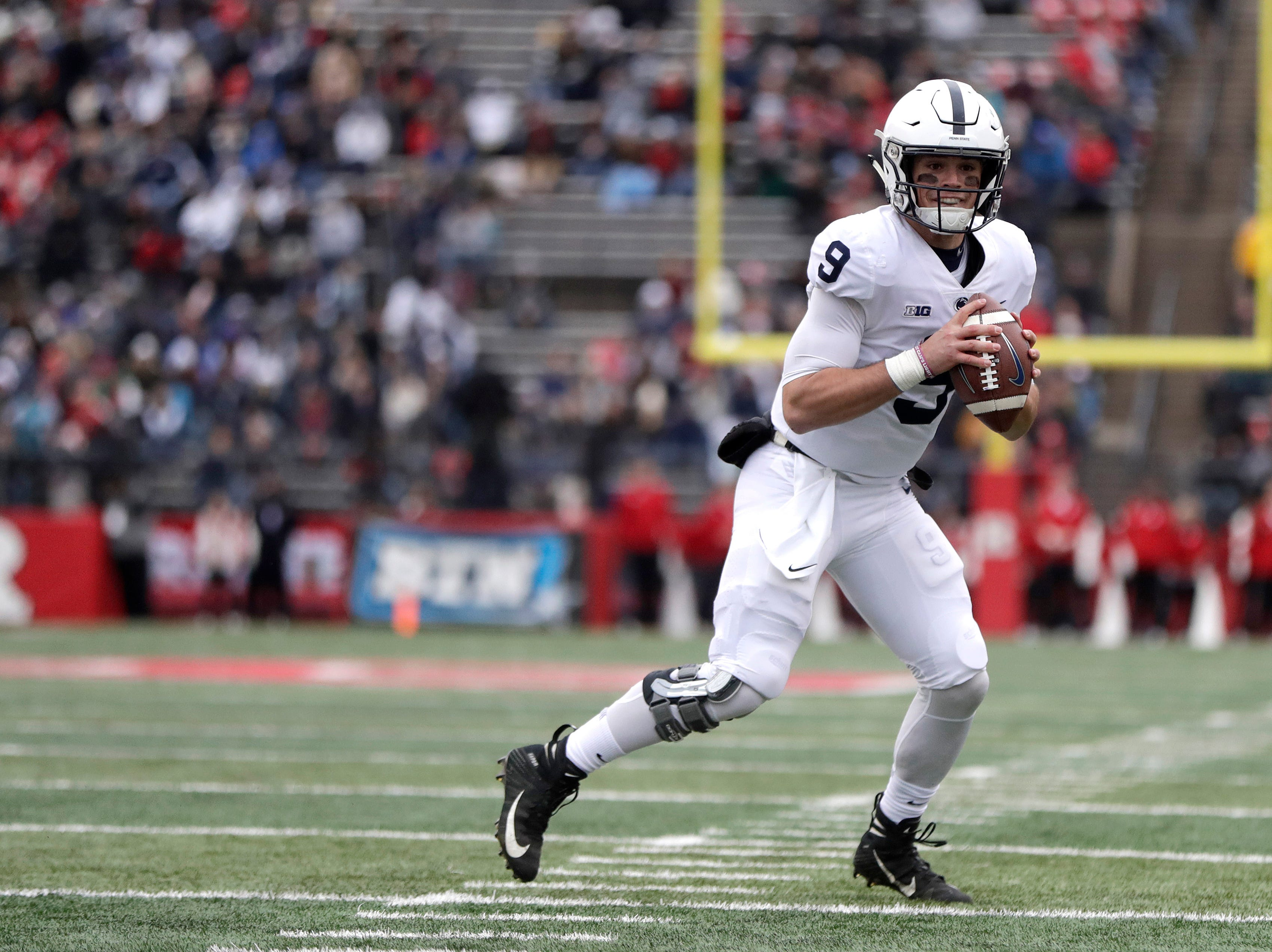Penn State quarterback Trace McSorley looks to pass against Rutgers during the first half of an NCAA college football game, Saturday, Nov. 17, 2018, in Piscataway, N.J. McSorley connected with tight end Pat Freiermuth for a touchdown on the pass. (AP Photo/Julio Cortez)