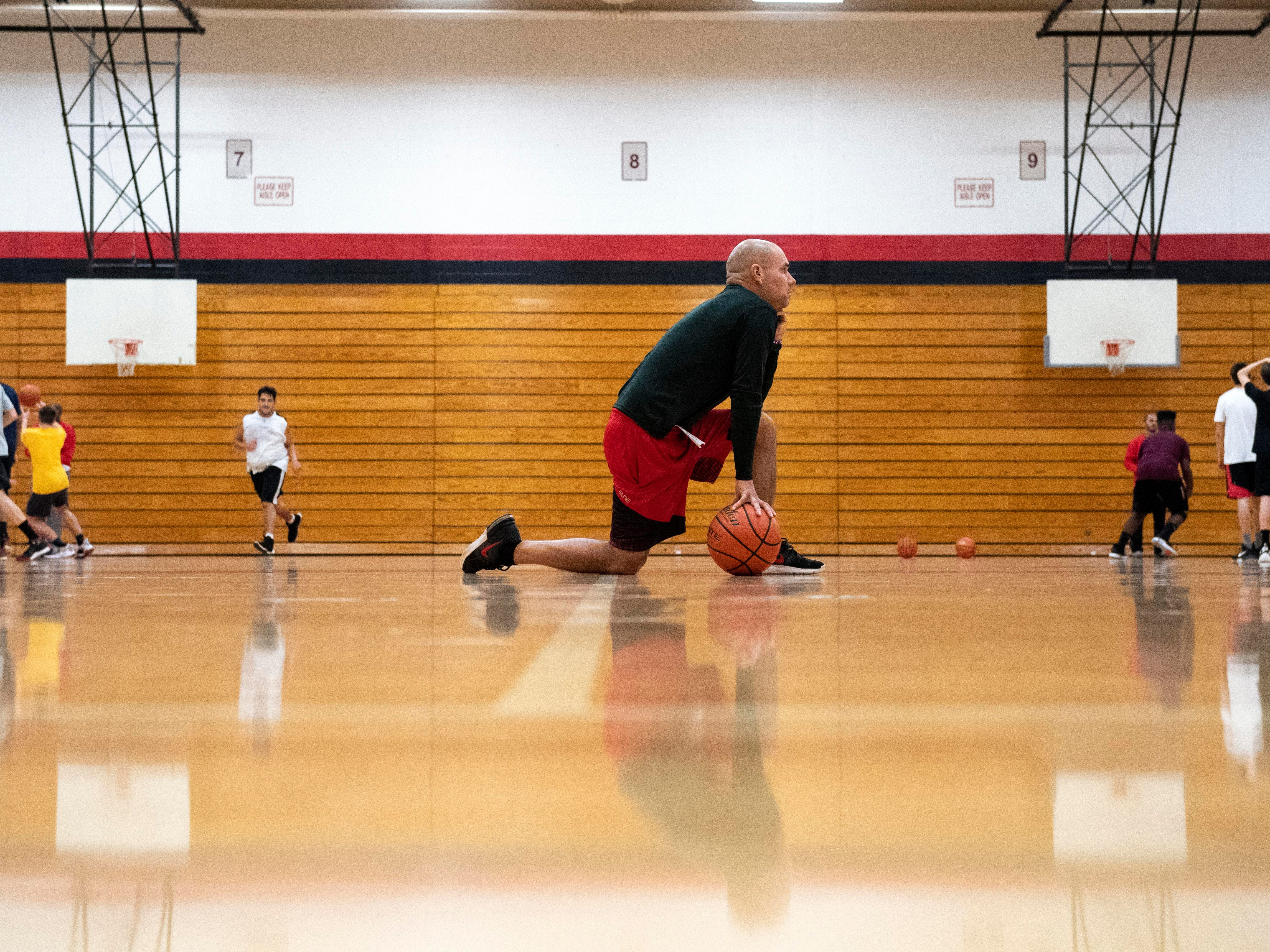 Dover boys' basketball head coach Brian Schmoyer watches practice during the first official day of winter sports practice on Friday, November 16, 2018.