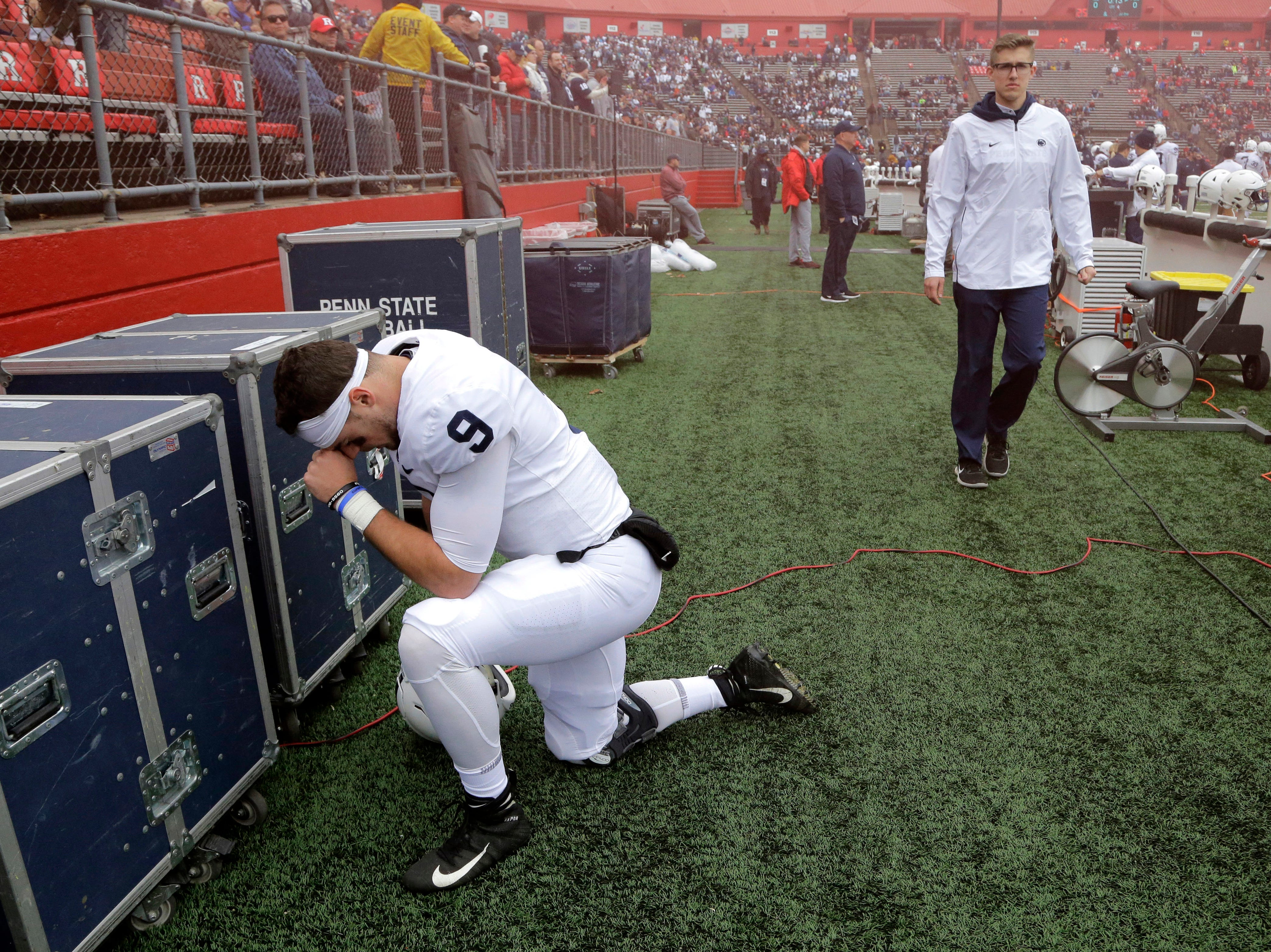 Penn State quarterback Trace McSorley takes a moment to himself prior to an NCAA college football game against Rutgers, Saturday, Nov. 17, 2018, in Piscataway, N.J. (AP Photo/Julio Cortez)
