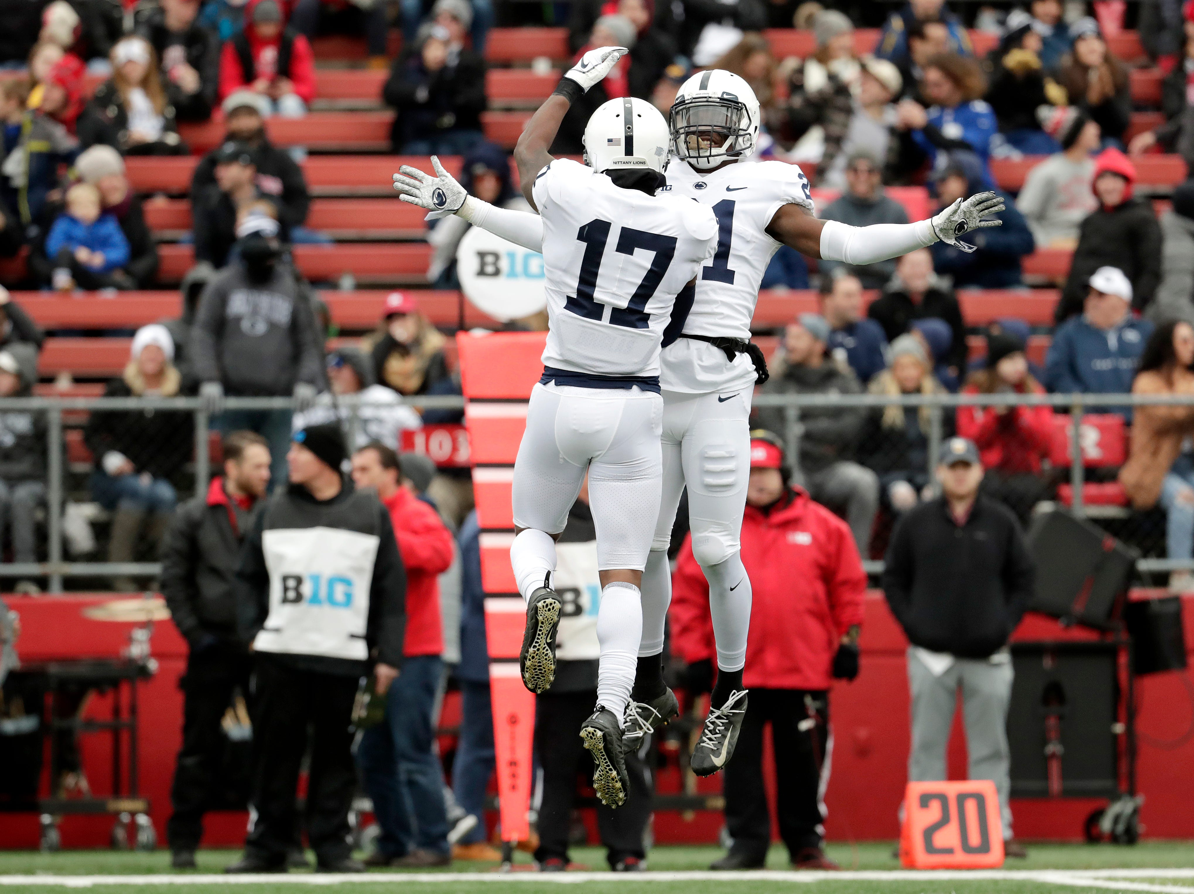 Penn State safety Garrett Taylor (17) celebrates his interception off a pass from Rutgers quarterback Artur Sitkowski, not pictured, with teammate cornerback Amani Oruwariye (21) during the first half of an NCAA college football game, Saturday, Nov. 17, 2018, in Piscataway, N.J. (AP Photo/Julio Cortez)