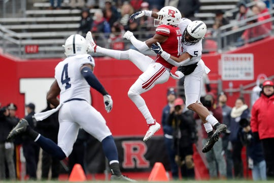 Rutgers wide receiver Bo Melton, center, makes a catch as Penn State cornerback Tariq Castro-Fields (5) and safety Nick Scott (4) defend during the second half of an NCAA college football game, Saturday, Nov. 17, 2018, in Piscataway, N.J. (AP Photo/Julio Cortez)